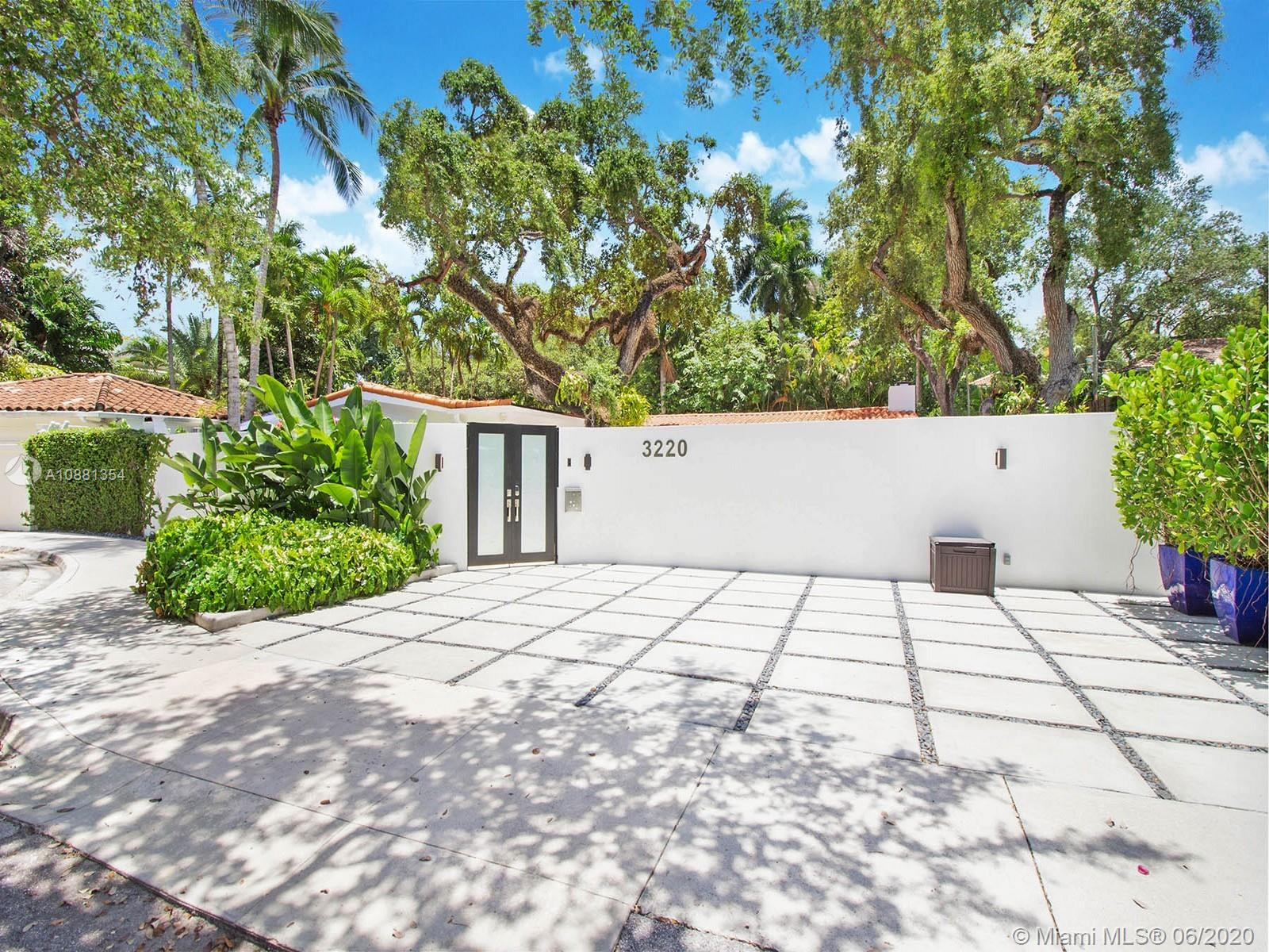 Tucked behind a private gated entrance this North Coconut Grove renovated residence graces a cul de sac with the best urban access in Miami. Stunning banks of impact glass sliders open to the newly refinished pool area and multiple exterior living areas. Handcrafted imported eat-in Italian kitchen is outfitted with Wolf and SubZero appliances, 180 bottle wine cooler and organized built-ins. Vaulted ceilings and upgraded lighting systems encompass the newly redesigned modern masterpiece filled with custom finishes and contemporary features. White Iceberg 48x48 marble and hardwood flooring flow throughout the spacious one-story home with a flexible floor plan. Main house 3/3.5. Separate 1/1 guest casita. Stroll or bike to the Village. Best walkability to schools, hip cafes and the Bay.