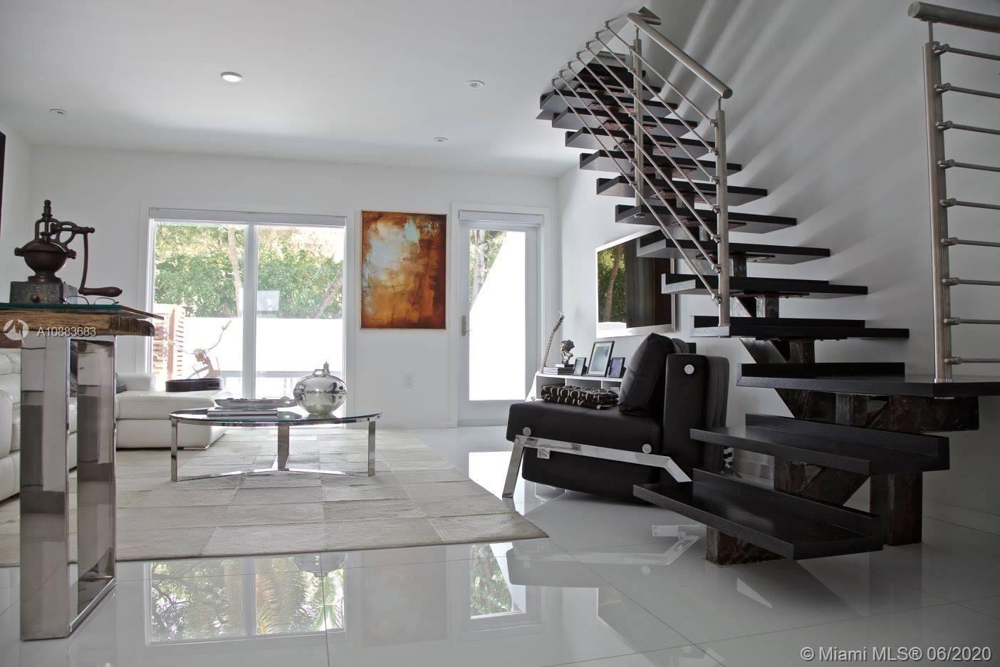 Completely remodeled Townhome in Key Biscayne! Perfect for investment or to live the island life. 1 bedroom/1 bathroom. Pristine white porcelain tile throughout, modern white kitchen w/designer stainless steel appliances (Liebherr, Miele),  architectural floating wood/metal staircase by Bellastairs, master bedroom upstairs w/custom closets, private patio/terrace w/marble flooring. Walk to the beach. Centrally located to the restaurants, shops and park. Maintenance includes cable, internet, water/sewer. Pet friendly. Parking space located directly in front. Short term rentals min 30 days accepted.