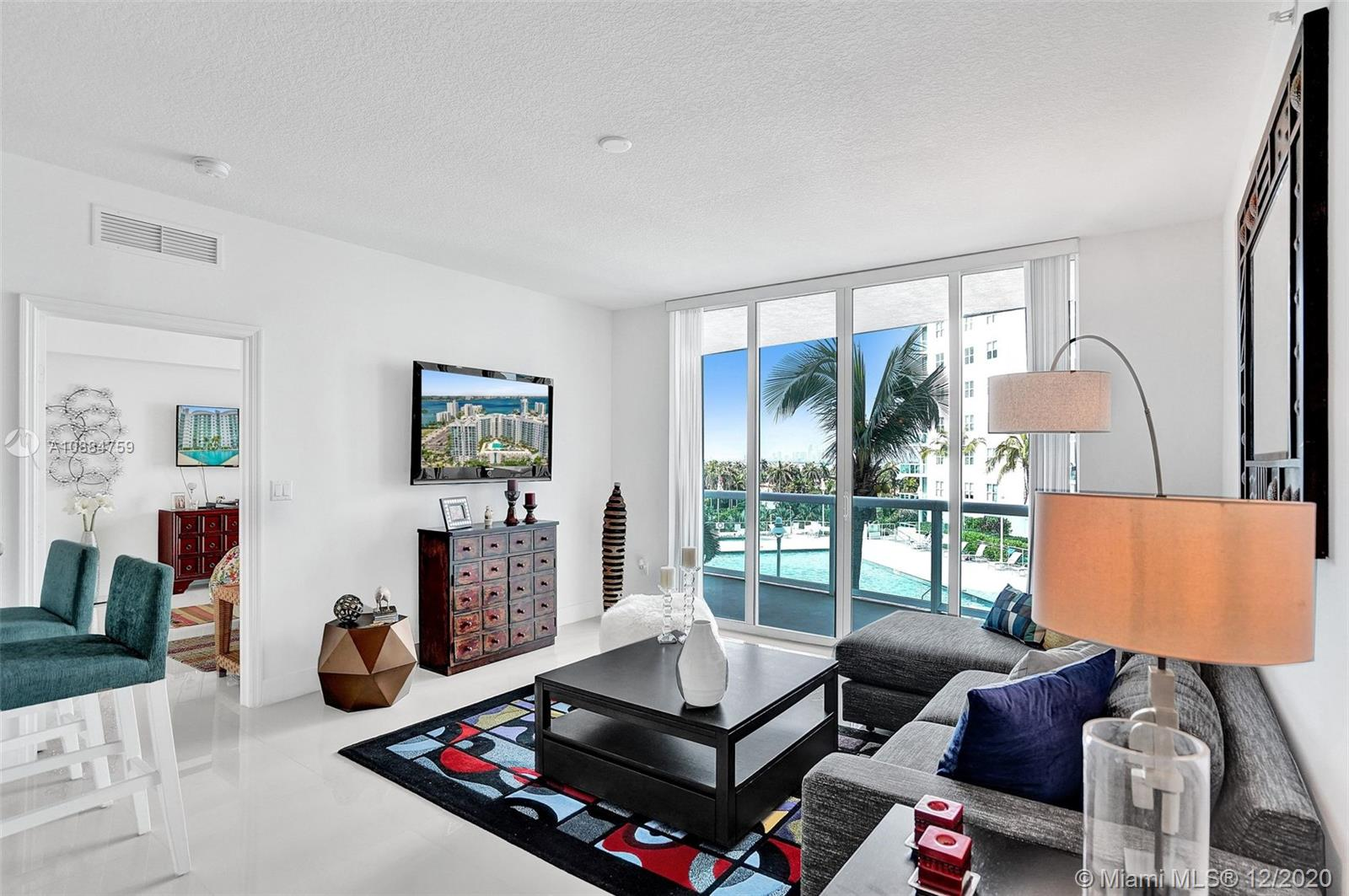Spectacular unit at 360 condominium. It offers an expansive balcony, tiles floors throughout, a Euro style open kitchen with GE Profile appls. and one assigned parking spaces. This unit is in impeccable ready to move in condition. 360 offers a private marina, 24 hr. security & concierge, free valet parking, fitness center, 2 heated pools and EV charging stations.