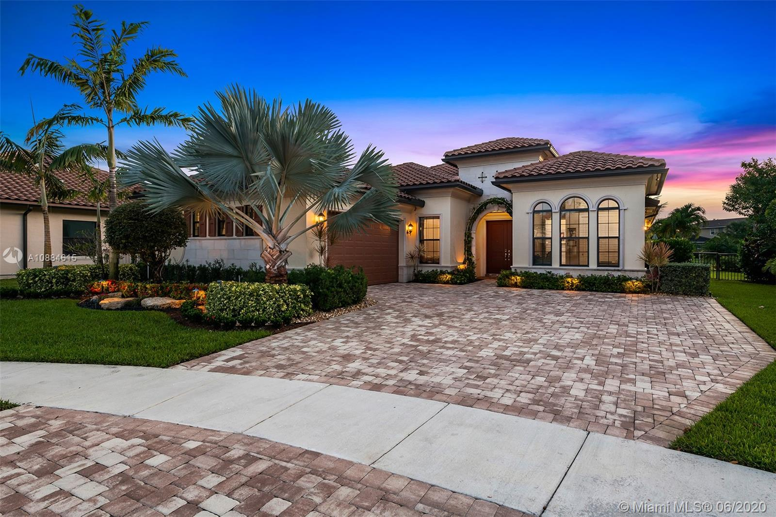 Wow! Here is the one you have been waiting for! Come see this rarely available move in ready Hibiscus model with all the bells and whistles. Located in one of the most prestigious neighborhood's in Parkland. This Heron Bay smart-home features a triple split floor plan with 4 bedrooms & 3 bathrooms. This open concept layout is perfect for any modern family. Be delighted with the recently updated chefs kitchen featuring Kitchen-Aid appliances, gas stove, double ovens, granite countertops and a wine fridge! Home also features custom built-ins and whole home generator. Enjoy some family time in your own backyard oasis with a screened in lanai, Van Kirk Pool with infinity spa, tanning shelf & swim jets. There is also a BBQ gas hook up for your out door kitchen. Come see this one today!