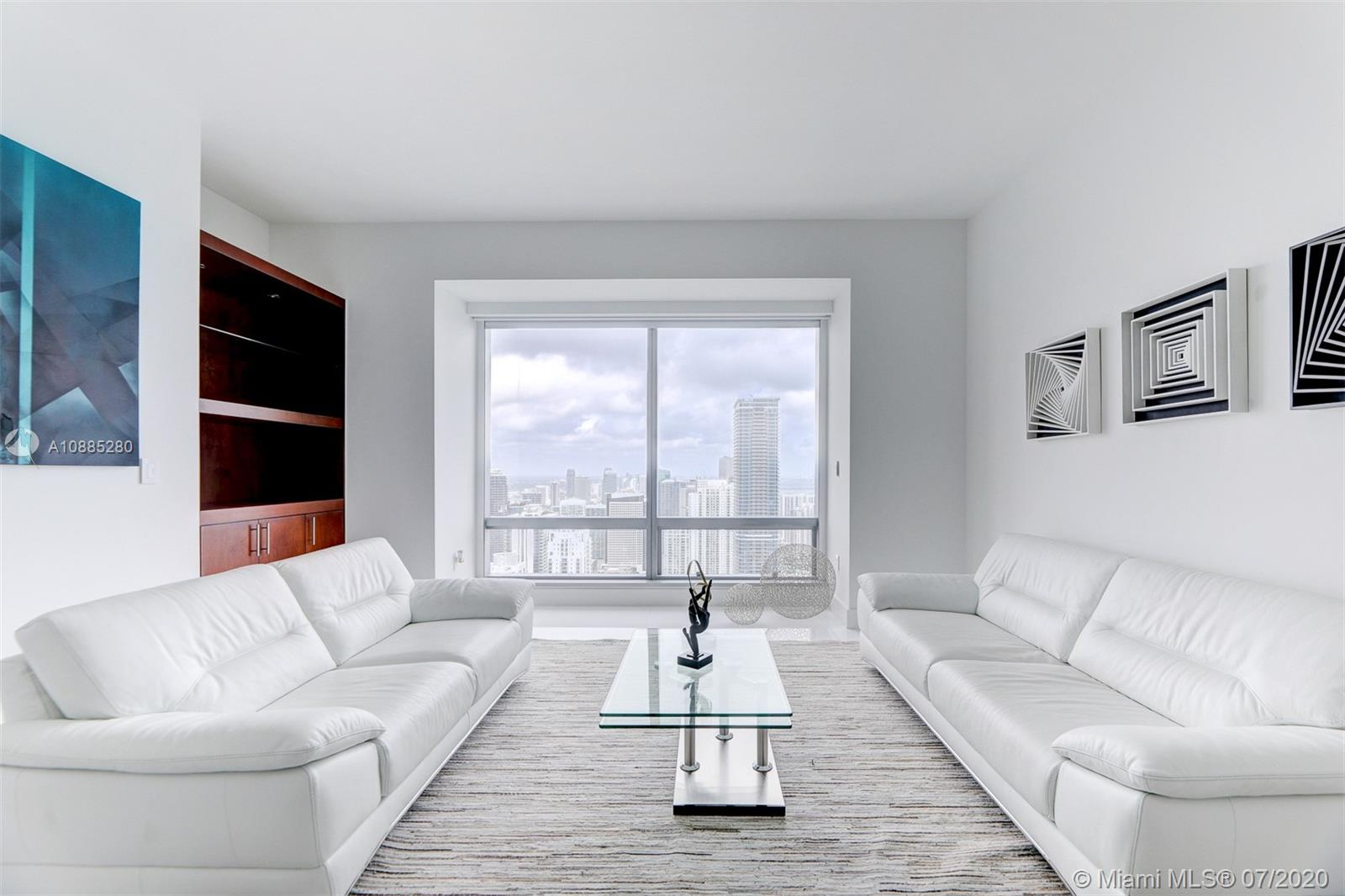 """WORLD CLASS, Five Star living at the """"Four Seasons Residences Miami"""" awaits. This unit features gorgeous white Quartz floors with breathtaking views of the Miami Skyline, Atlantic Ocean, and Biscayne Bay. The Master Suite is spacious with over-sized walk-in closet, deluxe master bathroom with marble tub and separate shower, and views of the Miami skyline. The gourmet kitchen features top-of-the-line Viking appliances, built-in wood cabinetry, and wine cellar. Laundry room located within unit with washer/Dryer. Unit is being sold with a storage unit! Other luxury features include impact r. windows and electronic blackout blinds. Available furnished and unfurnished. Lavish Hotel amenities include: Gym, Valet, Spa, 3 pools, Cabanas, Room Service, 24-hour concierge and much more!"""