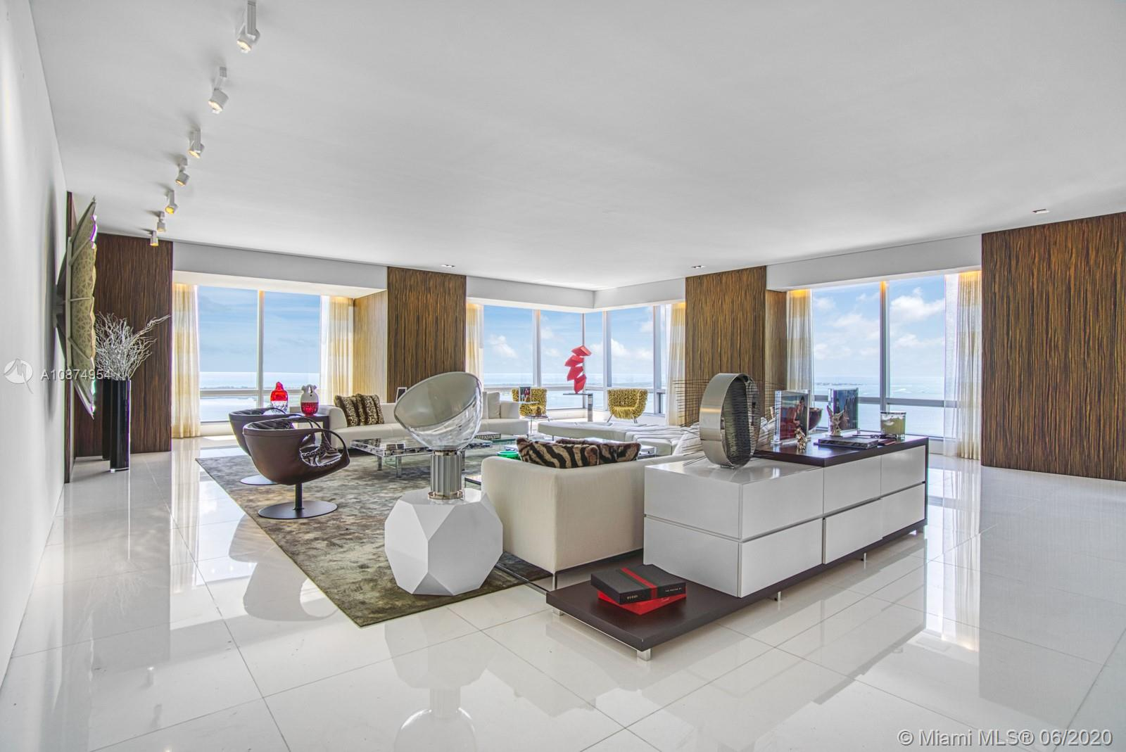 This world-class Four Seasons Miami residence offers extraordinary views of Biscayne Bay and Miami from almost every room. This magnificent corner unit combines the sought-after E & F lines into one incredible open floor-plan with spacious living room, formal dining room and large gourmet eat-in kitchen. Offering 5 expansive bedrooms with custom wood paneling and built-ins and 6.5 bathrooms with custom mosaic tile work. The Four Seasons Residences offer 5-star service, endless amenities, and an unparalleled luxury living experience. Unit offers 4 garage parking spaces and has a prime Brickell location close to dining and shopping. Unit Sq Ft total for 52EF is 7,104 combining 52E 3,357 and 52F 3,747 unit sq ft.