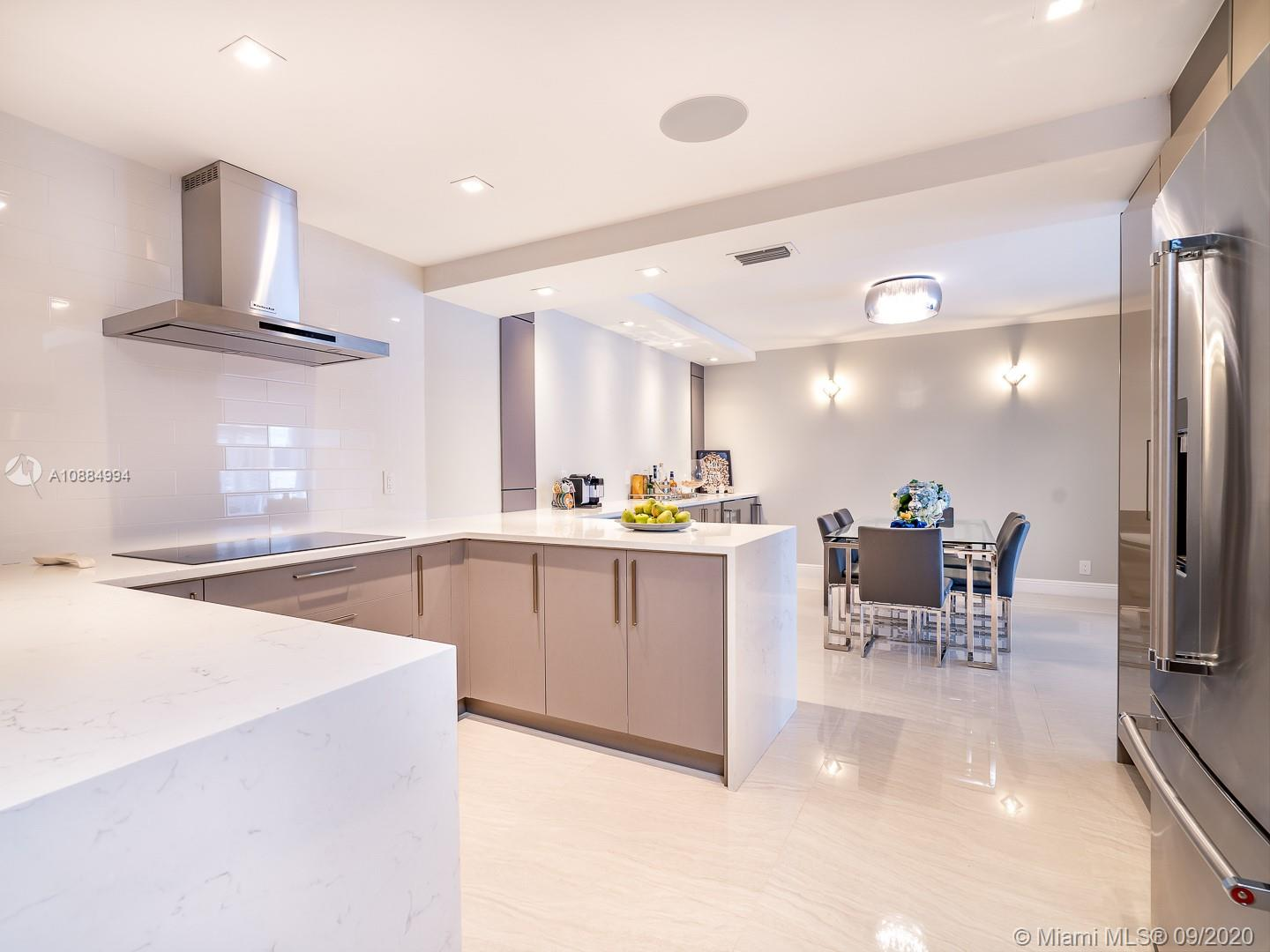 TOTALLY REMODELED APARTMENT WITH 3 BEDROOMS, 3.5 BATHROOMS. CUSTOM MADE KITCHEN, WITH A SEPARATE DINNING AREA, HUGE LIVING AREA FACING THE BALCONY WITH BAY AND PARTIAL OCEAN VIEWS. PORCELAIN TITLE THROUGHOUT THE APARTMENT.