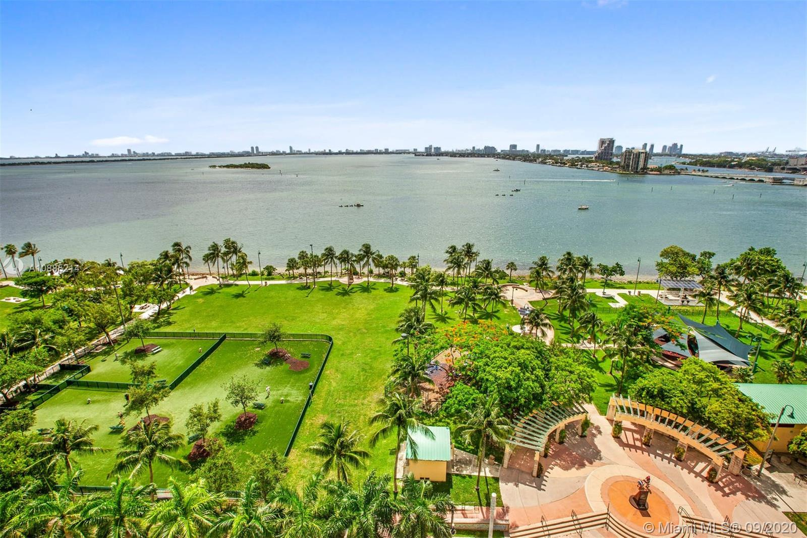 Enjoy the open, beautiful views of the Biscayne bay & park from this spacious & renovated 3 BD /3 BA corner unit. Professionally designed by Brazilian architect Fernanda Negrelli. The open kitchen, LR & den are integrated spaces. Inspired by French & Chinese architecture you will see handcrafted wood window panels on the walls, amongst many more design details. Abundant amount of natural lighting flows through the apartment as the living room has breathtaking views of Biscayne Bay. Triple balconies accessed from each bedroom. Amenities include private + valet parking, concierge, pool as well as fitness facilities. This unique apartment us in mint condition and ready to be moved into right away.
