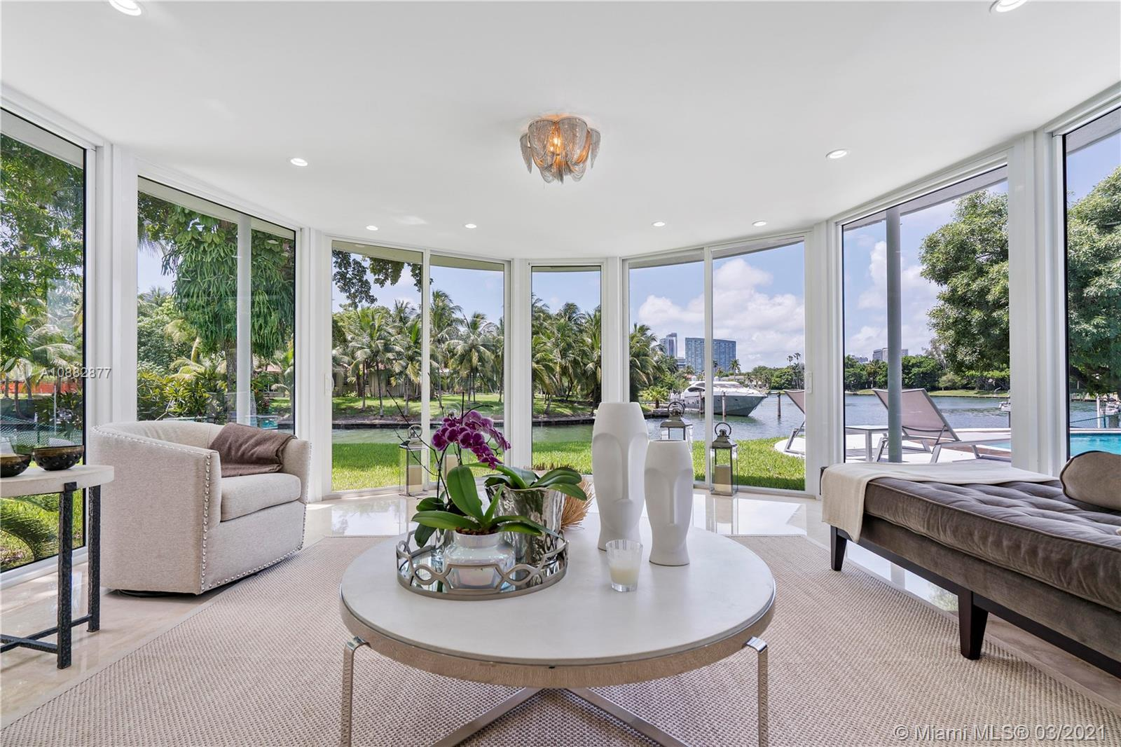 ONE-OF-A KIND PRIME ESTATE WITH 123 FEET OF WATERFRONT AND UNOBSTRUCTED BAY AND SABAL LAKE VIEWS LOCATED IN SOUGHT AFTER BAY POINT PRIVATE GATED COMMUNITY. Make a fresh start or expand up to 9,000 SF this existing mid-century home built by renown architect Wahl Snyder. This south facing 18,656 SF trophy lot offers a protected harbor with dream water and Miami skyline views from all property angles and uninterrupted yearlong coastal breeze. The substantially renovated 3 bed 3 bath current home may be rented or occupied during the design phase. This exclusive coveted community offers private roads patrolled by 3 security guards 24/7. Perfect for families looking to be close to the best private schools in Miami. Close to the Beach, Design District, Midtown, Wynwood, Museum and Art's District.