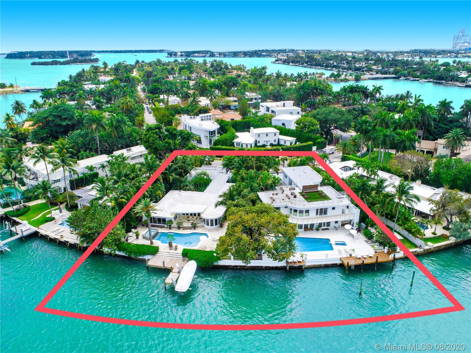 MiMo STYLE TROPHY COMPOUND WITH 210 FT OF OPEN BAY WATERFRONT PERCHED ON THE TIP OF RIVO ALTO ISLAND'S DOUBLE POINT LOT & LINED WITH A CURATED EXOTIC BOTANICAL GARDEN! Pristine Compound Inspired by MiMo Design w/ 10,041 SF of Living Space & 28,376 SF Lot. Main Residences + Separate Guest Houses Including a Total of 9 Bedrooms+10 Baths+2 Half Baths. Stunning Pool & Deck Area Hugged by Palm Trees. Terrazzo Flooring & Fresh White-Washed Brick Walls + Built-in Bookcases. Kitchens Equipped w/ Wolf & Miele Appliances + Subzero Refrigerators. Villas Adorned w/ Statuario Marble + Shimmering Mosaic t/o. Baths Covered in White Subway Tile w/ Marble Tub. Each Bathroom Carries its Own Unique Style w/ Various Mosaic Textured Walls. Ipe Dock & Outdoor Kitchen w/ DCS & Viking Grills. Expansive Rooftop.