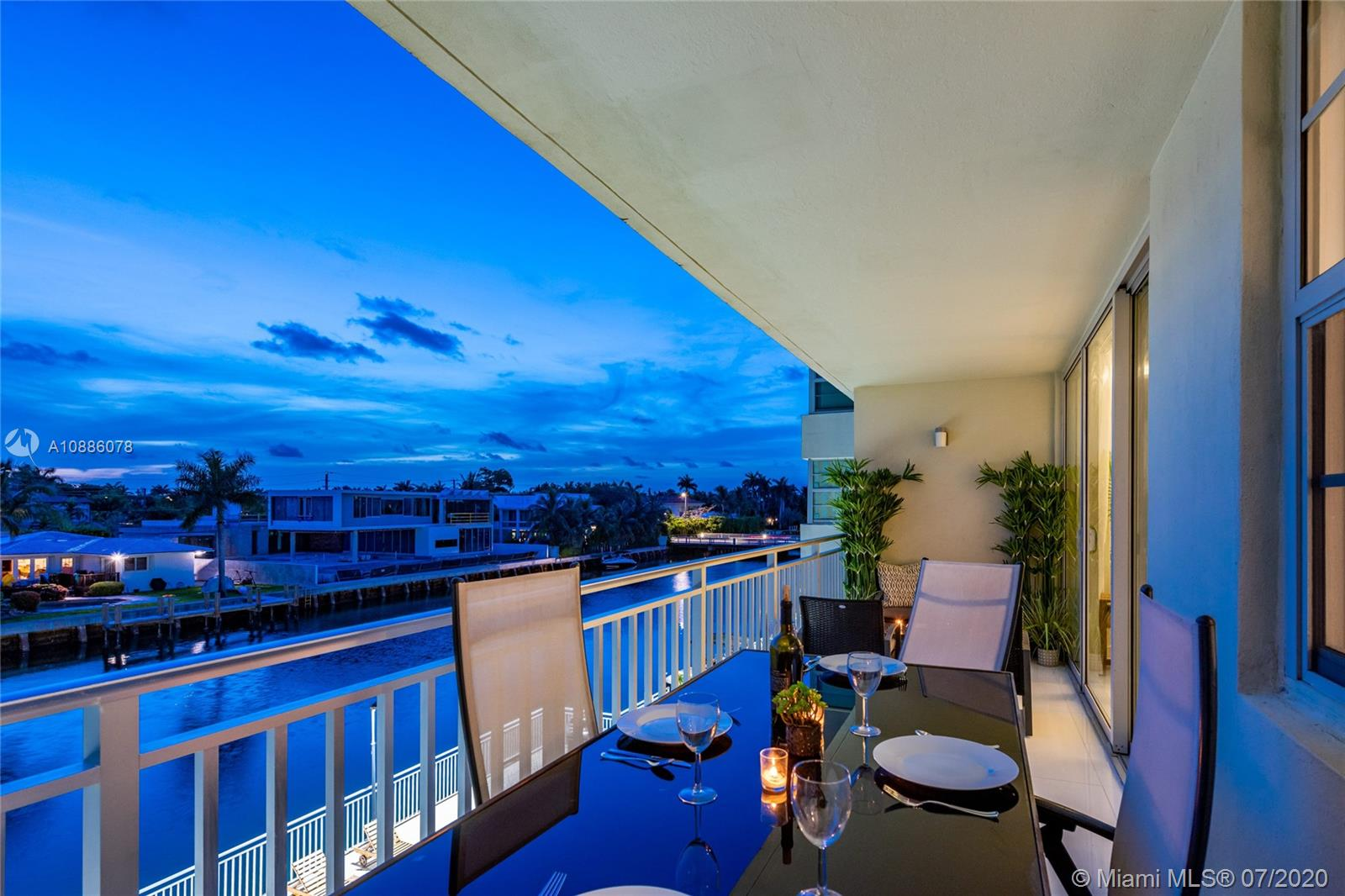 Live superbly in this completely updated intracoastal waterfront unit. Carefree open flow living, dining and expansive balcony—perfect to relax with a glass of wine or host a twilight dinner party to enjoy the glistening water and boats go by. Beautifully renovated with white marble and French Oak wood floors, designer baths, luxe lighting and an open gourmet chef's kitchen. Unwind in the large master ensuite with double vanities, illuminated mirrors and incredible walk-in closet. Special treat—an enclosed den that's perfect as a second bedroom. Even better—the furniture's included! All in a boutique waterfront condo with pool, club room, covered parking and dockage. An ideal getaway in a great Bay Harbor location, near Bal Harbor shops, just a block to Ruth K. Broad Bay Harbor K-8 Center.