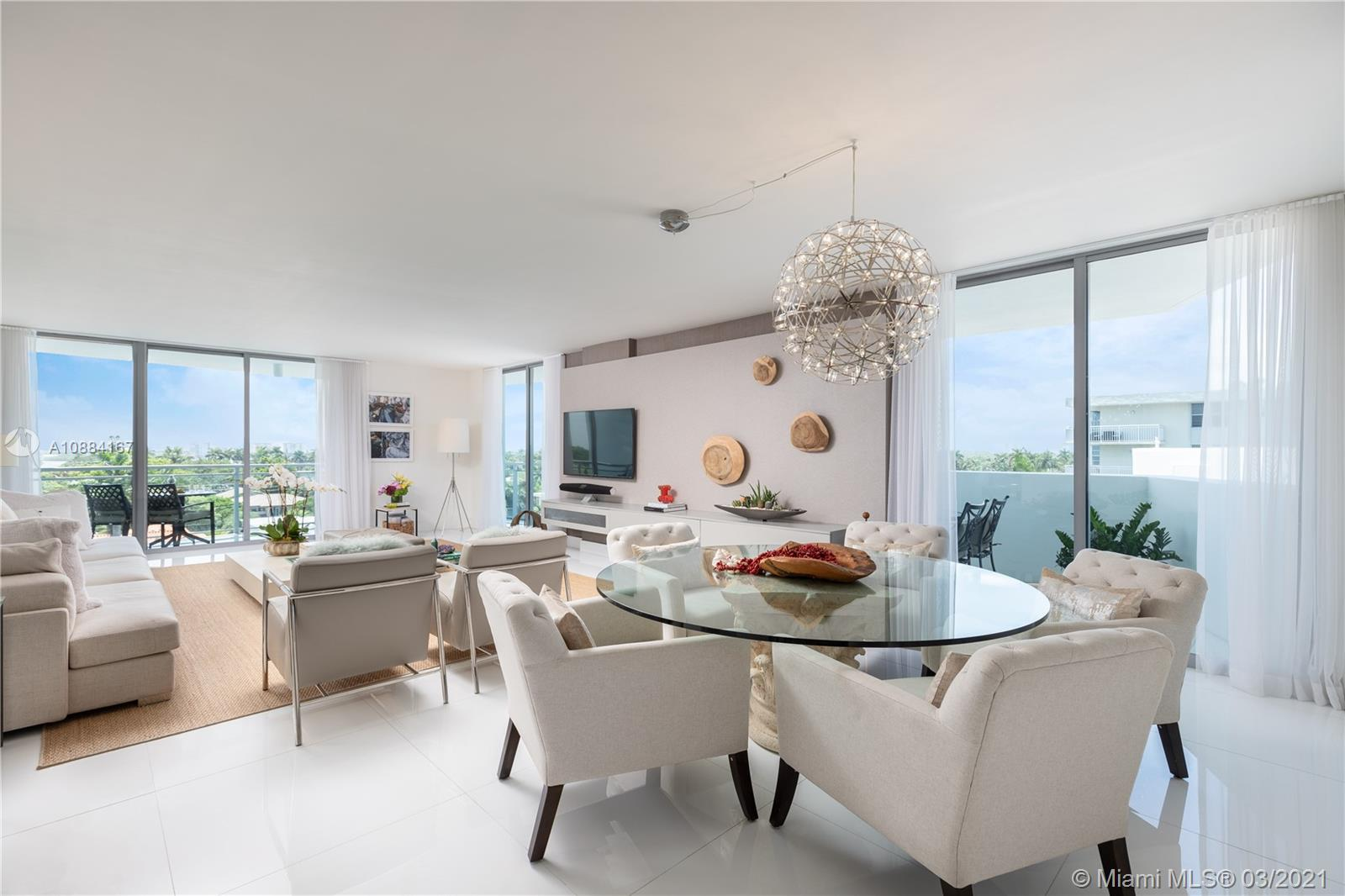 Upgraded flowthrough high-floor corner unit at Riva Bay Harbor, a 25-unit boutique waterfront building, completed in 2013, less than a mile from the Bal Harbour Shops. Riva 604 overlooks Biscayne Bay with unobstructed north, west and east views. A private elevator foyer opens directly to this spacious 3 bed / 3.5 bath with two terraces. Reflections of light off the water highlight the Brazilian modern ambiance of interiors by Artefacto, featuring white quartz countertops and white porcelain floors throughout. Enjoy abundant storage closets and high-end appliances. Relax in your own peaceful oasis with full-time security, valet parking and front desk attendant. Catch the perfect sunrise, dip in the rooftop pool, or stroll through the quaint two-island town of Bay Harbor Islands.