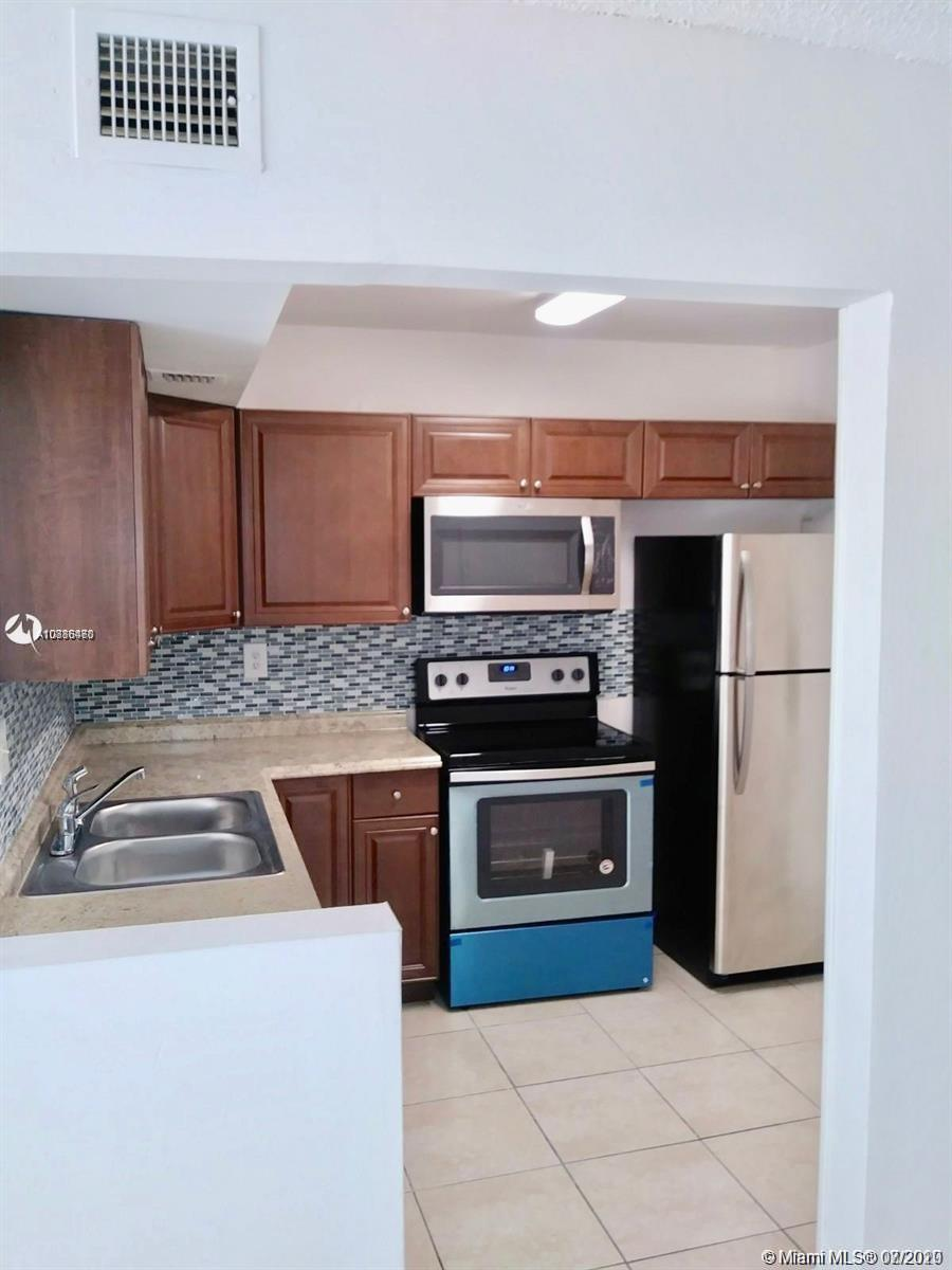 2 bedrooms 2 bathrooms Condo, slightly new kitchen, A/C recently replaced, clean white tiles on first floor unit, multiple parking space, laundry on-site. Walking distance to Super Markets, Banks convenient 2 minutes from highways in a upcoming neighborhood. Lots of extra parking. Pictures were taken before rental.