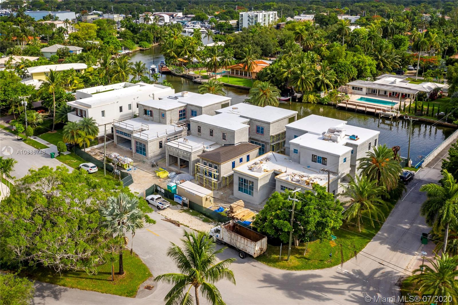 [UNDER CONSTRUCTION] Brand new luxury waterfront home in beautiful gated Belle Meade. Boater's dream with new seawall & dock, seconds to open bay with no bridges. Enjoy 5,385sf total, with 4br+office/4.5ba. Spacious light-filled living/kitchen/dining areas open to large covered lanai, summer kitchen, and salt-chlorinated pool with spa. Over 10' finished ceilings. Master features massive 16x10 custom closet. All bedrooms include en-suite bathrooms. True chefs kitchen includes full Subzero/Wolf appliances, huge island with built in table and PLENTY of storage in custom MIACUCINA Italian cabinetry. Impact windows/doors throughout. Permanent generator. Huge 2 car garage. Minutes from top private schools, Miami Beach, Design District, Wynwood, Downtown & more. ESTIMATED DELIVERY 3RD QTR 2020.