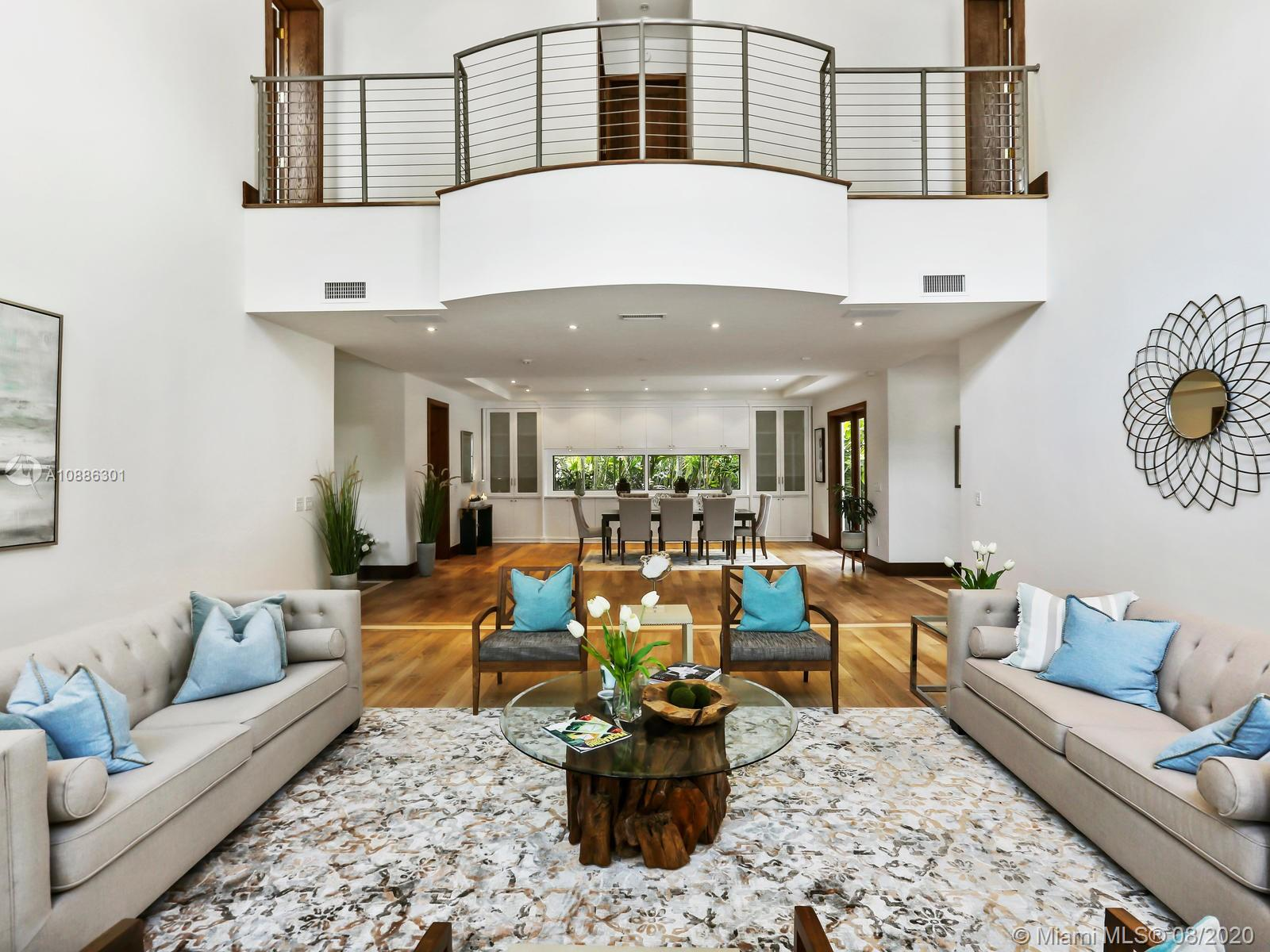Voted best high end value for exclusivity in South Gables. Remodeled 2-story home on nearly 30,000SF of lush land tucked away on cul-de-sac in Coral Gables' newly-approved gated community in Banyan Lakes near Matheson Hammock Park & Miami's top schools. Luxury living & private.7,256 SF of interior space offering tons of natural light, 10' & vaulted ceilings, Walnut floors,impact windows,6 beds with ensuite baths, master suite & 600-SF private terrace, great room with 24' ceilings,formal dining & chef's kitchen with marble island,2 refrigerators & Thermador gas cooktop/French grill.German Poggenpohl cabinetry. Entertainer's home offering a seamless indoor/outdoor flow to the expansive outdoor covered terrace,marble pool deck, 65'lap pool, cabana bath & garden. 2-car garage & NEW metal roof.