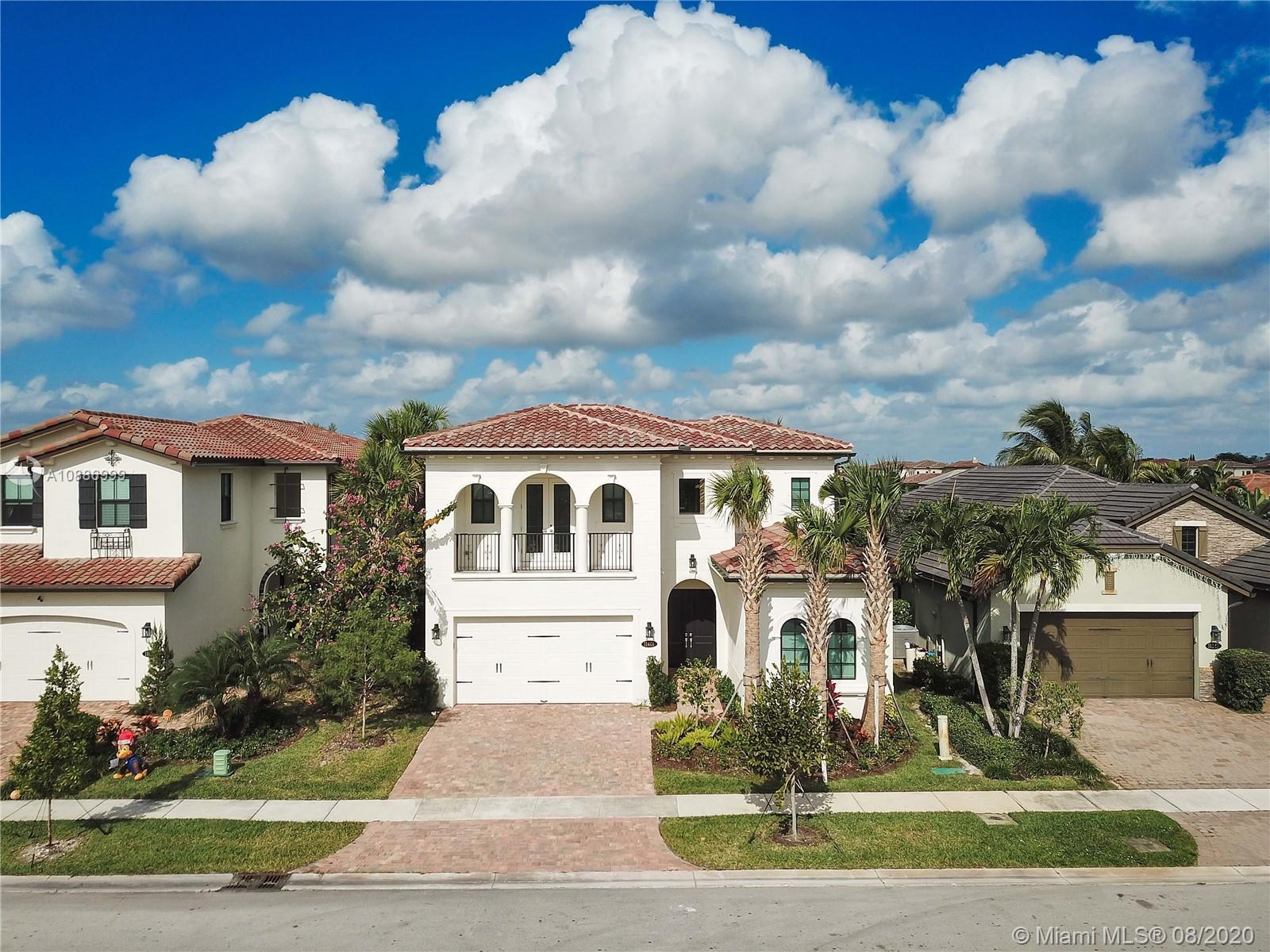 GREAT VALUE! REDUCED $32,000. This truly beautiful, brand new Estate Series, 2-story Provence model, built in 2019, has 3610 SF of living space & 4 bedrooms each with spectacular en-suite bathrooms. The master suite, on the ground floor, has twin walk-in closets, double basins & elegant finishes. The home has an exquisitely appointed kitchen. Features a den, an office, powder room, impact doors & windows, 10' ceilings, ample storage space & ceramic tiles on ground floor. The staircase is wooden. This beautiful home gets lots of natural lights. Includes a laundry room, 2 car garage. Backing onto a peaceful & calming lake, it sits in a gated community w/ night security patrol & included a heated pool,gym, children's play area & club house. Common & private gardens are maintained by the HOA.