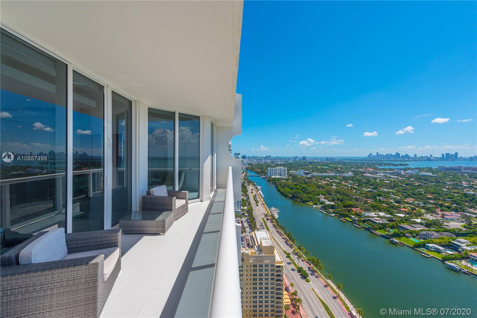 Enjoy breathtaking views of the bay and city skyline from this one-of-a-kind designed penthouse.  Throughout the condo are coveted features including floor- to -ceiling windows providing plenty of natural lighting; electric shades; LED custom lighting, high ceilings & marble floors throughout. The kitchen opens to a large living and dining room area, with top of the line appliances.  Expansive suite bedroom is a showcase. Being offered furnished. The Blue Diamond Condo is one of Miami Beach's most sought after addresses. Enjoy luxury beachfront living with five-star resort-style amenities.