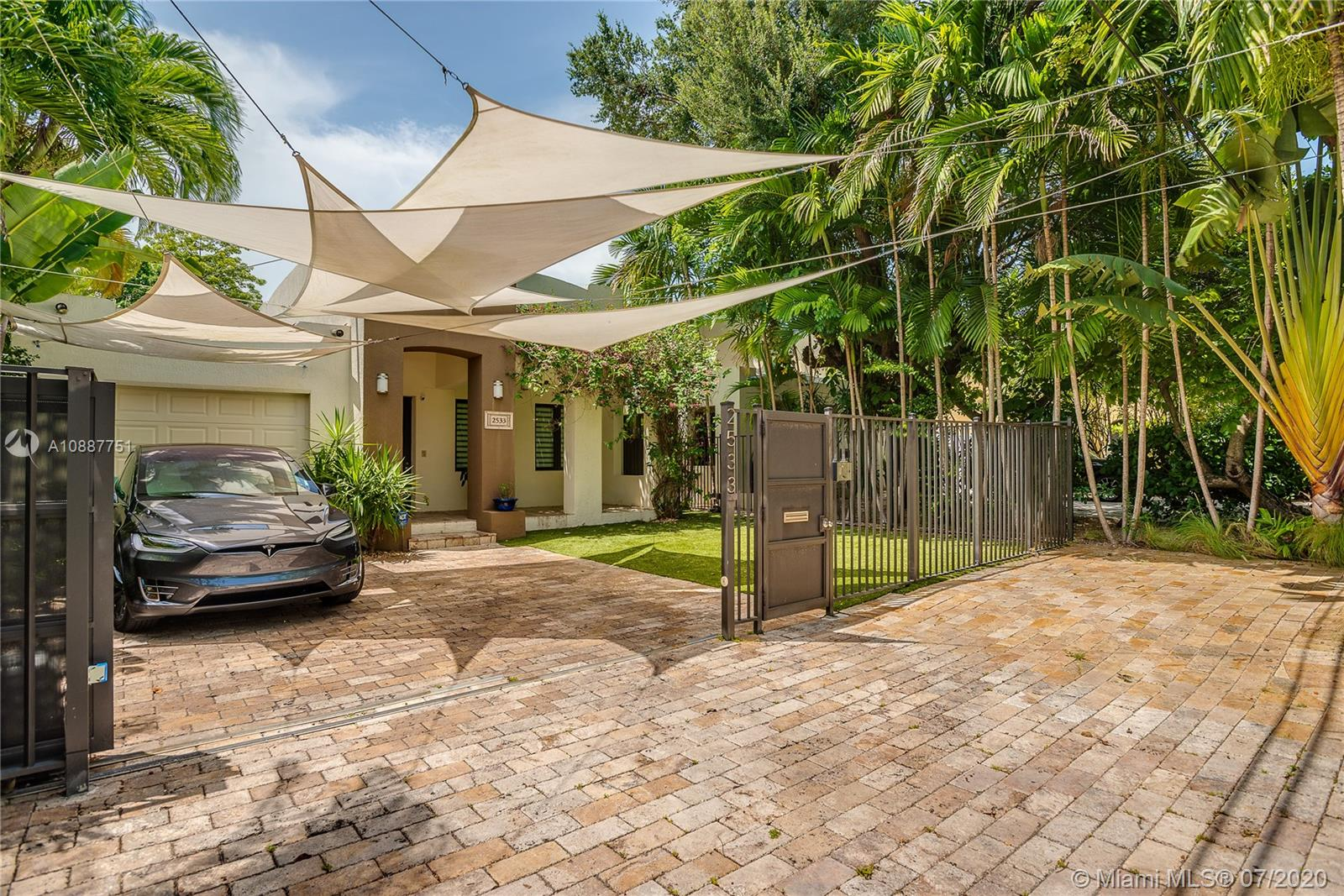 Private and secluded oasis in the heart of Coconut Grove. Open floor design; inviting ambiance and a practical professional chef's kitchen with gas stove for those who love to cook and entertain; large living room and wine cellar view from kitchen. Sonos stereo system throughout the house and patio with independent zones for comfort. Beautifully landscaped garden with lush vegetation, a pond with Koi fish, an intimate patio with plenty of seating for entertainment, pool table and a commercial gas BBQ.  Gated parking for two vehicles. The home also has 2 private entrances. Easy access to US1, walking distance to Metro Station, minutes from downtown, cocowalk, charming boutiques, galleries, gourmet restaurants, cafes and sailboats anchored at the Bay, several parks within walking distance.