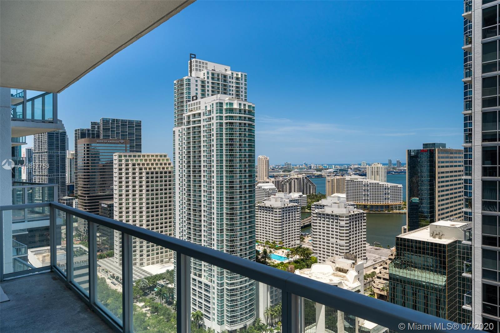 Welcome to the best value for a large 1 bed corner unit with large wrap around terrace with partial bay and fantastic skyline & sunset views located at 1050 Brickell. Features include: Brazilian cherry wood flooring throughout, Bosch & kitchen aid stainless steal appliances in your huge chef kitchen with tons of cabinet space, upgraded full washer/dryer, floor to ceiling windows in the living room with fantastic skyline views. The master suite is generously distributed with natural light as well as upgraded blackout blinds. Have access to your huge custom built walk in closet for tons of storage. Your master bath retreat includes a tub/shower as well as marble flooring throughout the bathroom. Walk directly into Mary Brickell Village to shops & restaurants. Steps from Brickell City Centre.