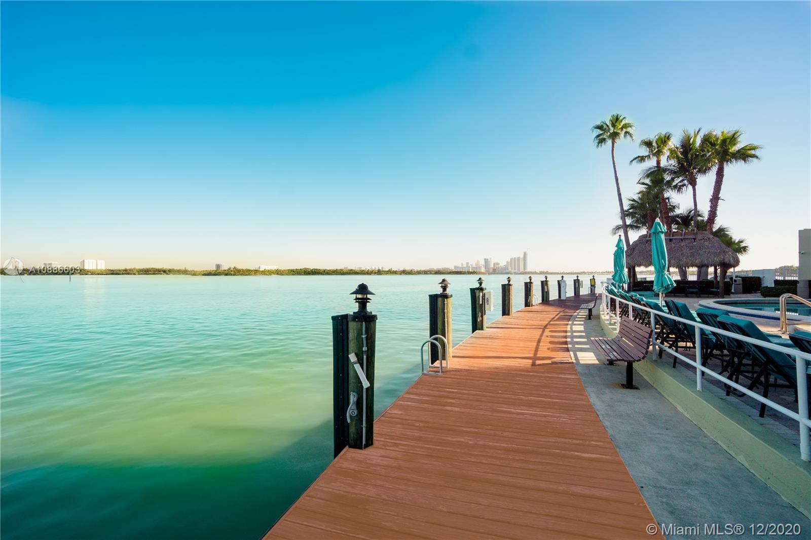 MUST SEE- Boater DREAM HOME- Available Dock or you can build your own lift. One of the largest units with 1900 SQFT overlooking the turquoise watercolor combined with Miami Beach Skyline the minute you open the door of the apartment. The beautiful master bedroom(same size of the living room) with a master walking closet. Two balconies to enjoy the evening watching the water (one of them in the privacy of your room!). 