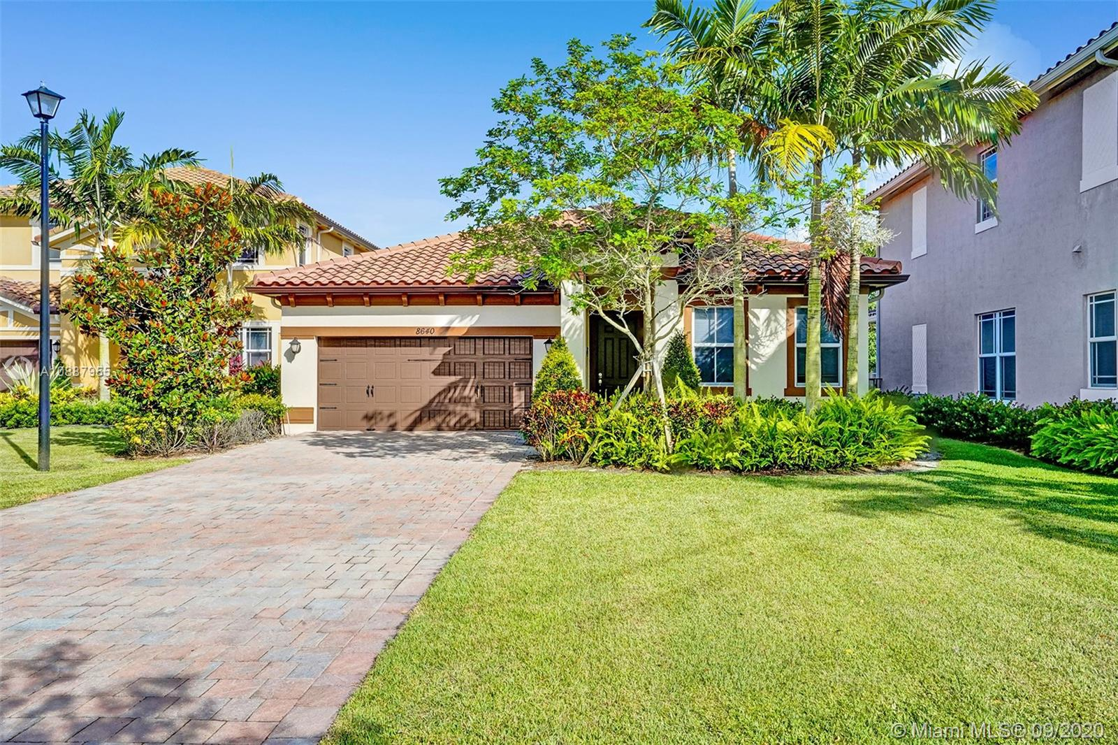 """WOW! GREAT BUY ON THIS HIGHLY UPGRADED CARLYLE MODEL ON A PRIME TIME CUL-DE-SAC LAKEFRONT LOT IN RED HOT MIRALAGO! CHERRY & GRANITE KITCHEN WITH STAINLESS STEEL APPLIANCES! 5 YEARS NEW WITH FULL HURRICANE IMPACT WINDOWS & DOORS! 20"""" DIAGONAL PORCELAIN """"SATURNIA LOOK"""" TILE AND MORE!"""