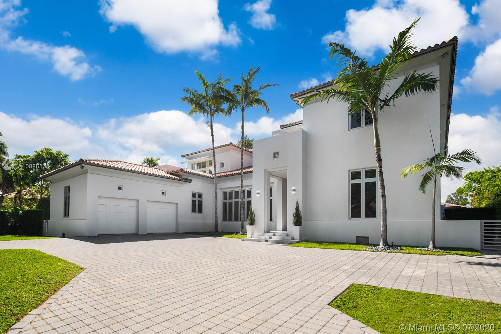 Tucked away in the prestigious gated community of Cocoplum in south Coral Gables, this custom-built 6-bed, 6-bath modern family home offers flawless upscale living. High ceilings, extra-tall impact windows, and gleaming white marble floors fill the home with light. Open layout flows directly to huge covered terrace, patio, and large salt-chlorine heated pool with spa for indoor/outdoor living at its finest Oversized chef-grade kitchen features top-of-the-line cabinetry, fixtures, and appliances, and connects to main family room for entertaining. Billiard room, bar, guest suite and maid's quarters all on 1st floor. Family bedrooms (all suites) and lavish master suite with sun deck on 2nd floor. Whole home generator, smart tech with mobile controls, elevator, and utility room also included