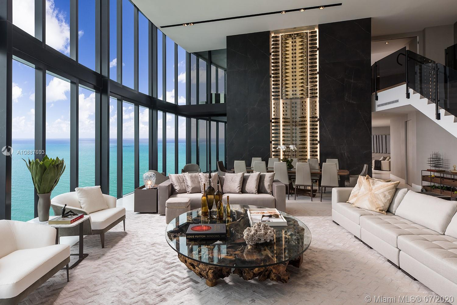 The finest residence at Porsche Design Tower! 5 bed /5.5 bath Trophy Mansion-in-the-Sky with interiors by Artefacto features 6,684SqFt & a 1,128SqFt, 4-car Sky Garage With Private Car Elevator so you can safely get into your 52nd floor Penthouse in complete privacy. Dramatic 21 ft ceilings, glass wine cellar, unobstructed ocean forever views, 3 living areas, private plunge pool, outdoor kitchen & 2 terraces complete the package. High tech upgrades include custom secured foyer entrance, Savant/Sonos AV system & electric shades. Porsche Design amenities include racing car & golf simulators, full-service restaurant, bar, room service, spa, pool & 200 ft on the ocean with beach service.