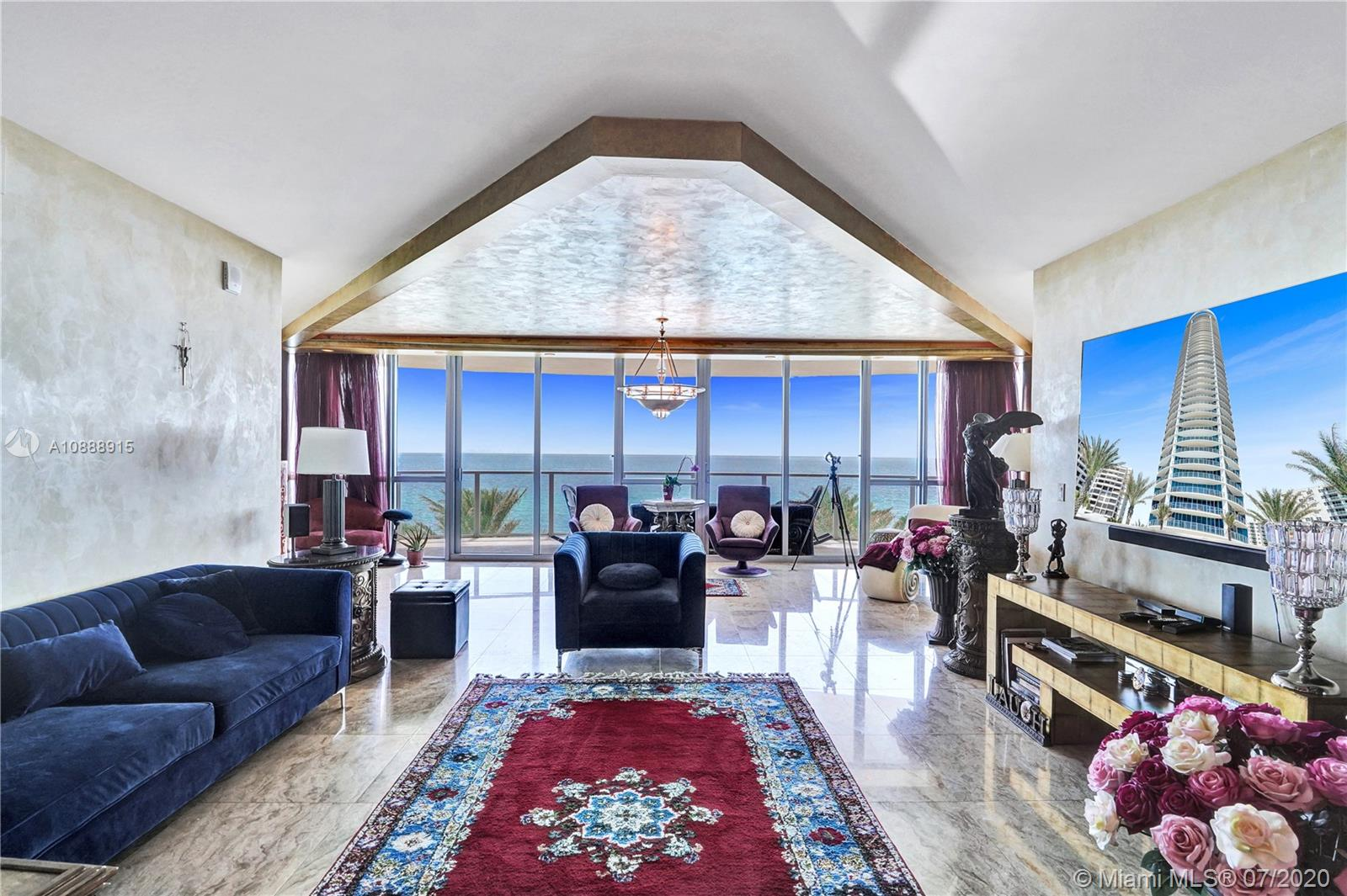 Welcome to your private waterfront palace at the Ocean Palms, Hollywood Beach! The most desirable line in the building, with 180-degree direct ocean views from every room. Private elevator that opens directly to the unit. Timeless & contemporary Venetian Plaster throughout the walls, & columns are wrapped in gold leaf in this elegant home. This residence features 3 bedrooms (easily converted back to 4 bdrms), 4.5 bathrooms, plus three large, private balconies to enjoy the most amazing views. Expansive layout offers an open kitchen w/ top of the line appliances and spacious living room and dining area. Building amenities include a 2-story fitness center, pool deck with spa and beach access, sauna, media center, BBQ area, dog park, tennis court, club room, valet parking, and business center.