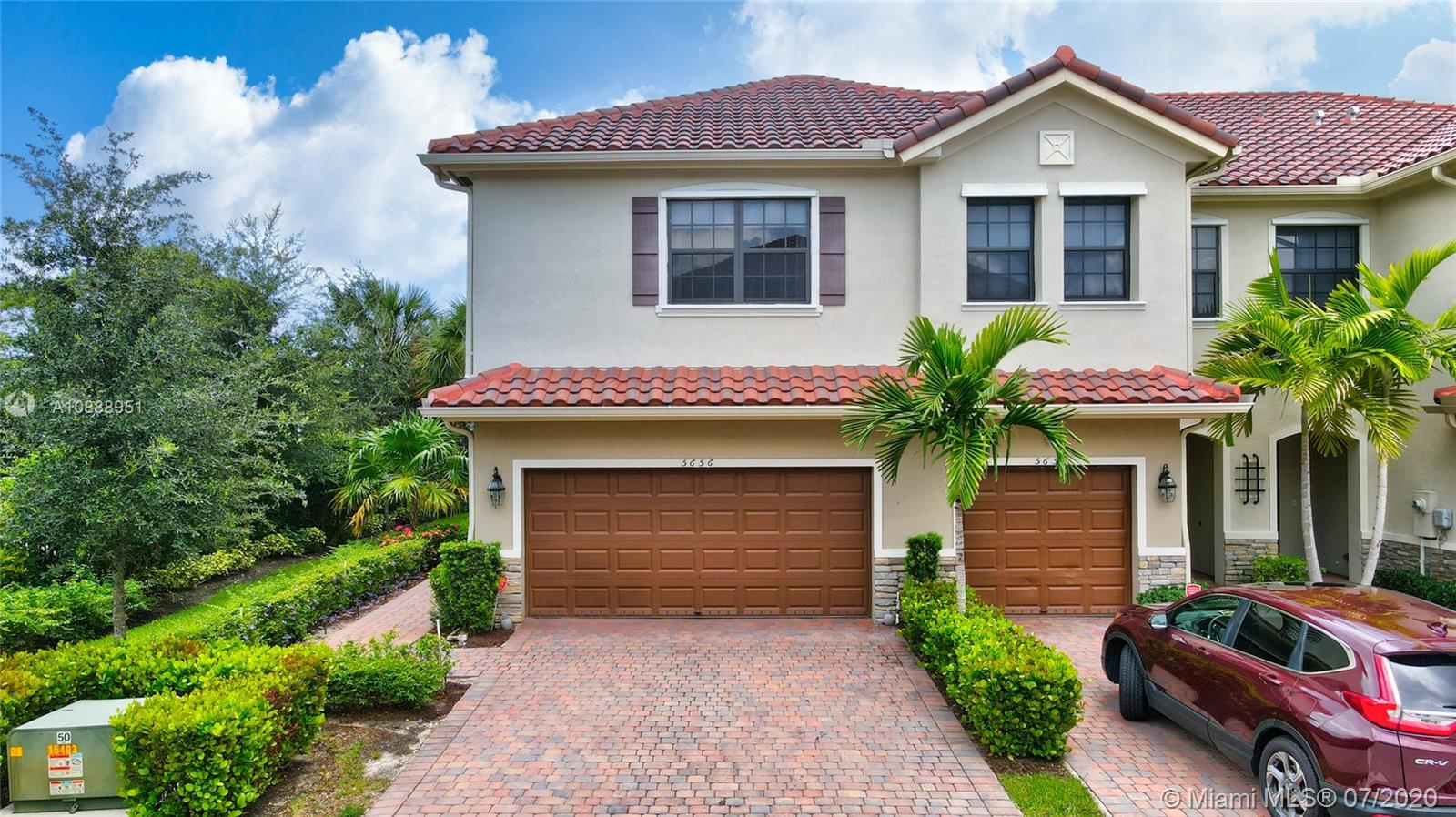 Beautifully maintained open floor plan townhome in Tamarac. One owner, built in 2016. With hand made barn doors, quartz counter-tops, wood finishing throughout, not one detail has been missed.  This rare corner unit has a large master bedroom  with large walk in closet and a master bath with dual sinks and walk in shower.  Each window is finished with drapes and fitted blinds. Half bath downstairs for guests. 2 car garage, extra parking, and a private back with paved patio and room for a grill leading to a huge grass field big enough for the kids to play and the dogs to run.  Enjoy the community pool and children's playground.  Convenient to all major highways and shopping.  Don't miss this one, its the one you are waiting for.