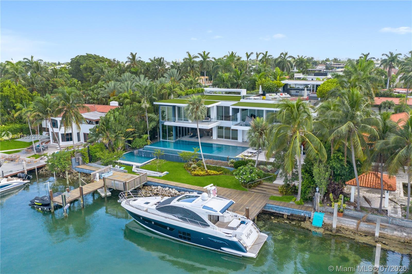 Exclusive Hibiscus Island Miami Beach modern architectural gem built 2016 on double lot w/122 ft of water frontage, South orientation. Designed by renowned architect Reinaldo Borges & landscape architect Raymond Jungles. 5B/5B + powder rm, white wood marble slab floors on 1st flr, wood plank floors on 2nd flr. State-of-the-art Crestron automation including all window shades, gourmet designer kitchen w/2 refrigerators Miele & SubZero, Wolf gas range, 2 wine coolers. Master bdrm w/ensuite office, 2 walk-in closets/dressing areas. Bowers & Wilkins home theatre, children's playrm, 2nd flr living area, elevator, dbl laundry rm + dry storage. 2 heated pools + sauna, cabana bthrms, outdoor living area w/complete kitchen & bar. Rooftop w/360 skyline views, jacuzzi & kitchen. 4 car garage, 2 docks.
