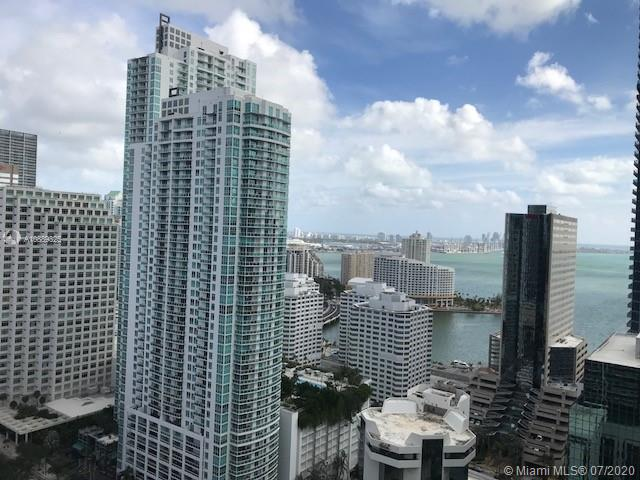 Spectacular corner unit, spacious and bright ! Highly upgraded by the owner, custom built walking closet, floor to ceiling impact windows. Amazing views of Miami skyline and Biscayne Bay. This unit has been decorated with modern furniture. Steps from metro mover and metro rail station, walk to Mary Brickell Village, restaurants, supermarkets, and recently opened Brickell City Center. Great amenities, fitness center, party room, gym, virtual golf room, cigar and wine room basic cable & water included. 24 Hour security.