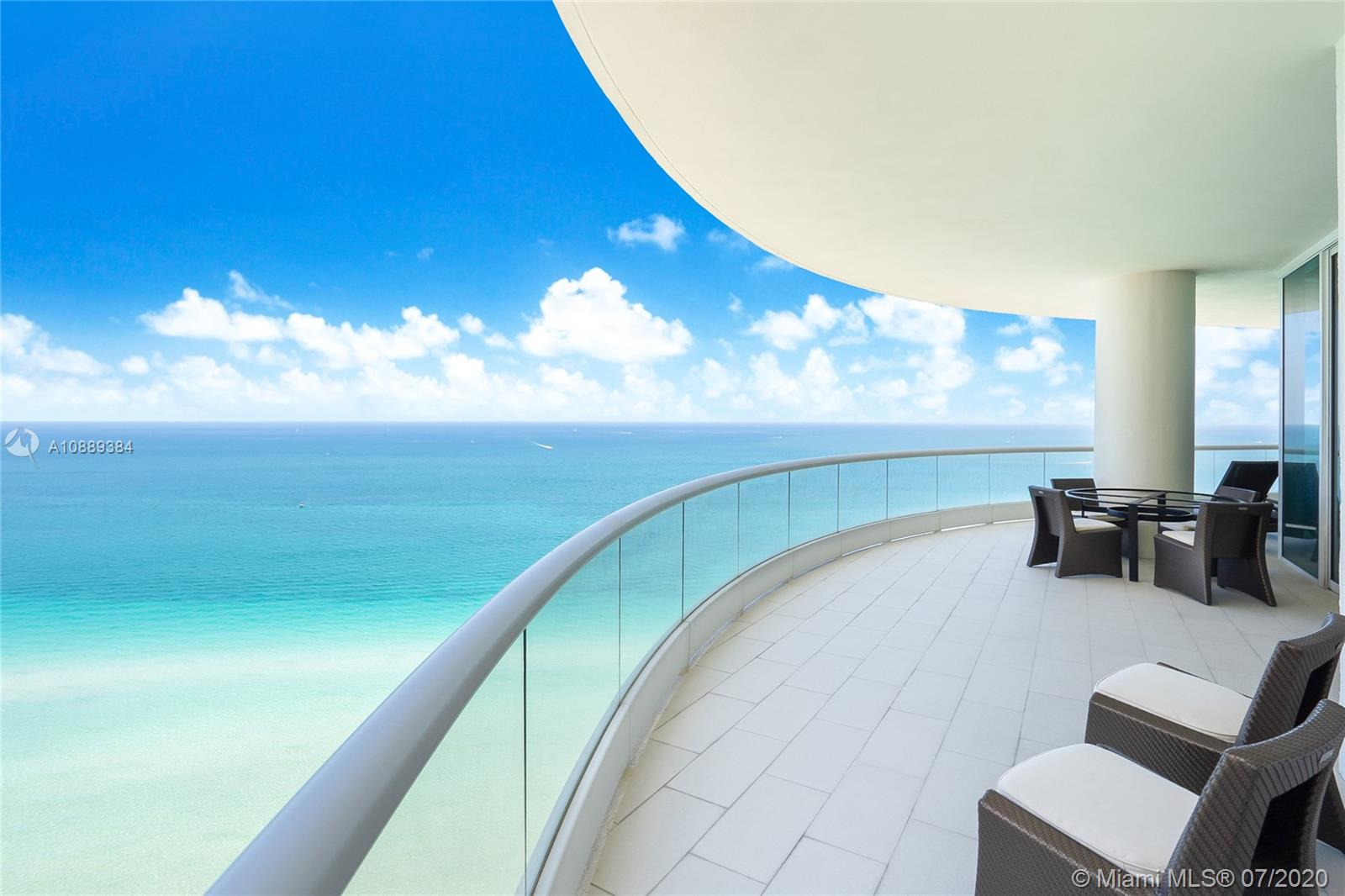 """Spectacular corner unit at the most elegant Turnberry Ocean Colony in Sunny Isles Beach. Panoramic views of the ocean, city, and Intracoastal. 4 Bedrooms, 5 Bathrooms plus media room and staff quarters. Private elevator. Professionally decorated, 10"""" ceilings, marble floors (living room, dining room area, and wet bar), carpet in bedrooms, and master bedroom facing the Ocean. Kitchen with top of the line Gaggenau and Subzero appliances and Sanidero Cabinets. Luxury lifestyle with a private club, 2 restaurants, fitness center, spa, beauty salon, sauna, jacuzzi, 2 pools, full-service private beach club, children playroom, billiard room, bar, lounge, business center, concierge, and 24 hrs. security. Ready to move in, easy to show."""