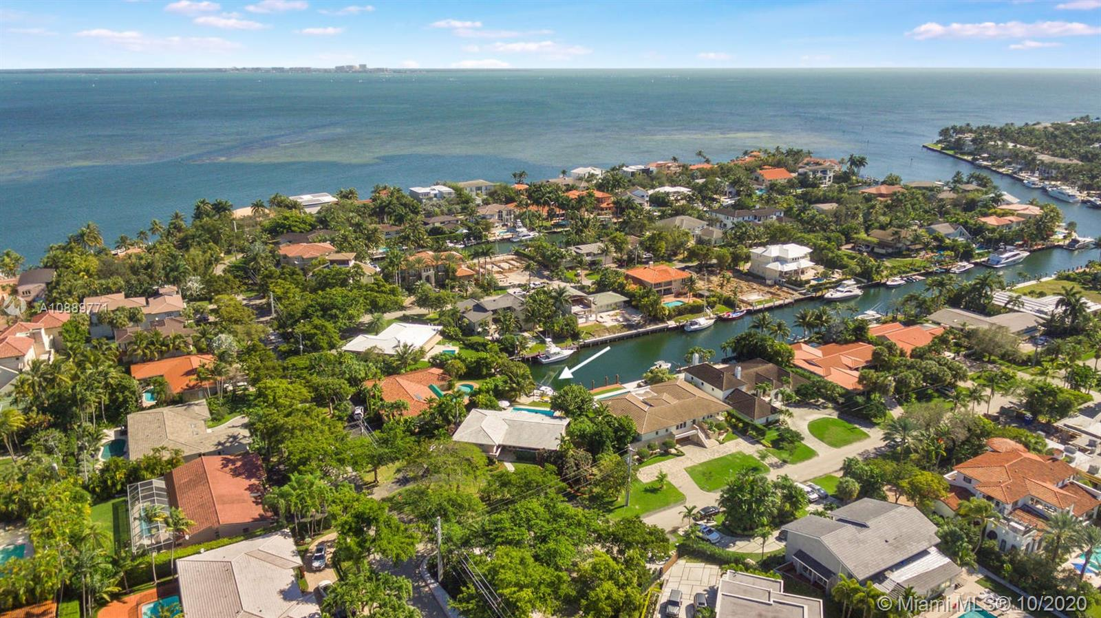 Endless possibilities await! The best value waterfront home in the coveted Sunrise Harbour gated community. This one-of-a-kind 2,568 SF 3 bed 3 bath waterfront home has no-bridge-to-bay direct ocean access. A grand entrance with circular driveway & stunning curb appeal greet you at the elevated split level Coral Gables residence. Partially renovated with updated kitchen, Impact windows & new roof. Entry level features open kitchen, dining & family rooms connected to an expansive patio overlooking the pool & private 30ft dock. Upstairs holds the bedrooms & main suite with balcony overlooking the water. Additional Downstairs level has 2 car garage, full bath, & den with private patio. Ready for move-in or renovate/rebuild on 15,700SF lot. 