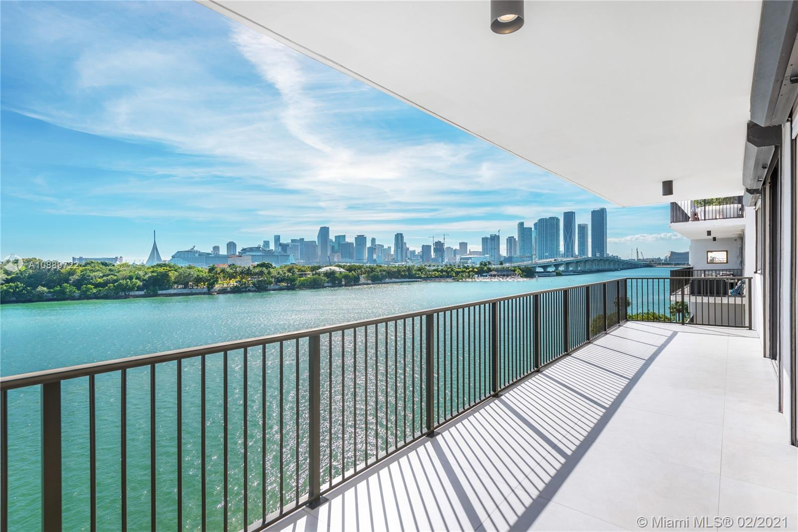 Light & bright sleek white modern residence boasts 3 beds, 2.5 baths, 2,010 SqFt & nearly 700 SqFt of 2 wide terraces overlooking Biscayne Bay, Cruise Ships & Downtown Miami Skyline. Enter through the semi-private elevator landing (only 2 units) into an expansive combined living/dining room area with unobstructed views, a perfect place for a quiet night in or entertaining guests. Enjoy a custom Italian Kitchen providing ample storage space, professional appliance suite & a generously sized stone topped center island. Spacious master offers the ultimate in privacy and magnificent water views through floor-to-ceiling glass doors. Amenities include double height gallery-like lobby, 24 hour security, valet, 2 bayfront pools & tennis courts.. One of the best building in Miami!