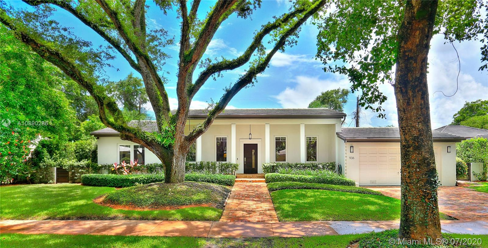 Absolutely beautiful South Gables Home! Contemporary colonial style home on prestigious & quiet street with majestic oaks on 12,000-SF lot. Lovingly restored & added onto, this home features 12-foot ceilings in the living & dining rooms, 2 family rooms overlooking the backyard oasis, gracious front porch with Chicago brick matching driveway & walkways, all impact doors & windows, & fireplace. Stunning new kitchen features a large eat-in island, gas range, SS appliances & modern white sleek wooden cabinets. Gorgeous backyard retreat offers a large covered porch overlooking the new pool with fountain, & spacious yard. Master suite boasts vaulted ceilings, walk-in closet & lux bath. Split floor plan with 2 bedrooms on one side, & master & 1 bedroom on the other, laundry room, & 2-car garage.