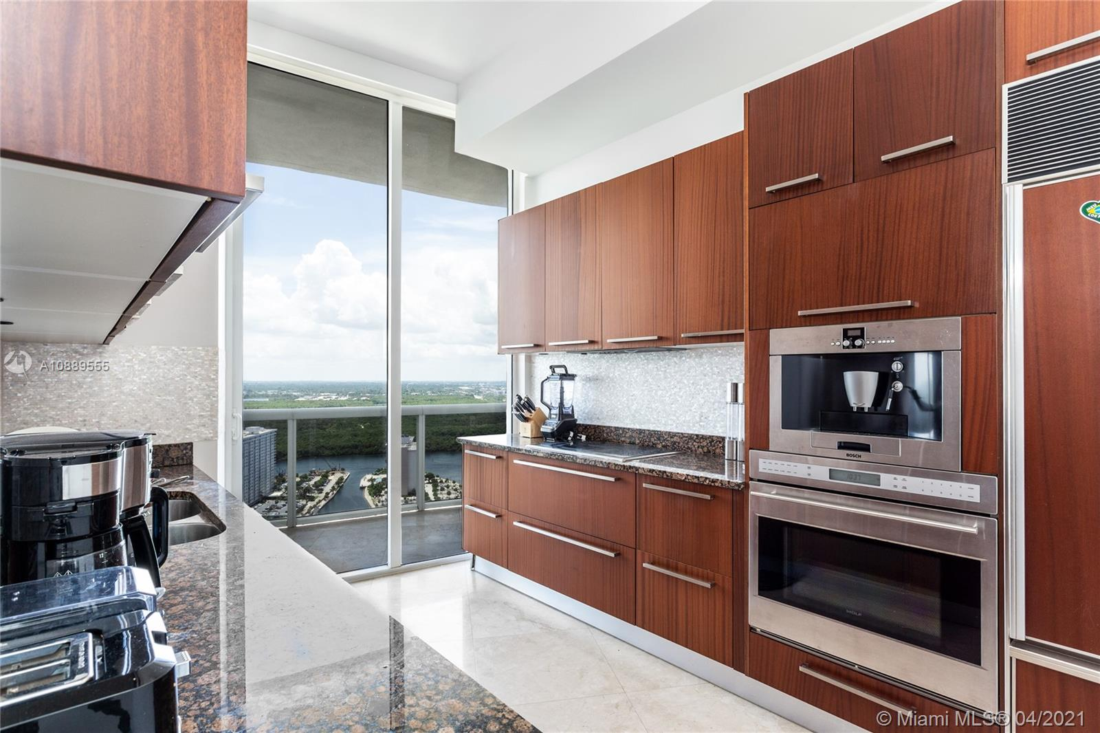 IMPECCABLE 34th FLOOR UNIT WITH BREATHTAKING INTRACOASTAL, DOWNTOWN MIAMI  AND BISCAYNE BAY VIEWS. SEMI PRIVATE ELEVATOR, MARBLE FLOOR THRU-OUT, GOURMET KITCHEN WITH SUBZERO, WOLF APPLIANCES. AMENITIES INCLUDE BILLIARDS ROOM, CLUB ROOM, POOL, SPA, FITNESS FACILITY, RECREATIONAL DECK, RESTAURANT ON THE BEACH. THIS UNIT FEATURES 10' CEILINGS. THE TRUMP HAS FULL SERVICE AND 5 STAR AMENITIES, BEACH SERVICE,  2 POOLS, AND MUCH MORE!