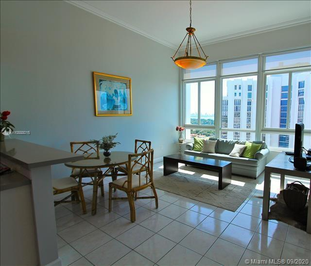Great unit facing the intracoastal waterwway, downtown Miami, Coral Gables,  Fisher Island, beautiful views day & night. Open area concept with high ceilings, large living, dinning room & kitchen all facing the water & cities. Spacious bedroom with with large closet & nice bath.This unit will make you feel like you are on vacation year round with the amenities like pool,tennis court, gym, tiki bar, restaurants , convenience store, etc.  with out living home.