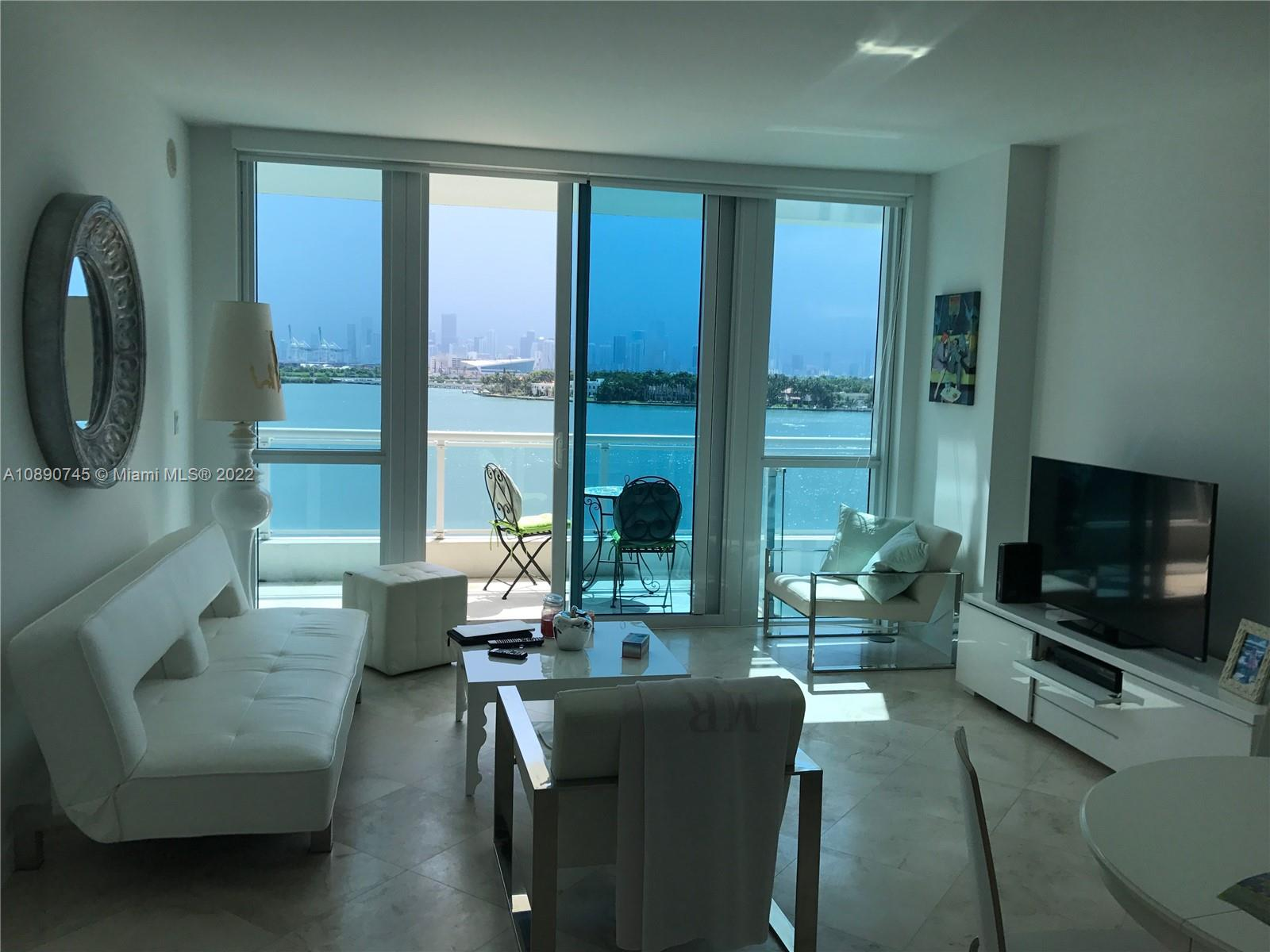 Stunning views from this Bay Front 1 Bed/1 Bath at the Iconic Bentley Bay, incredible and unique  views of Biscayne Bay, the Downtown skyline, and watch cruise ships sail out to sea.white marble floor , Italian marble countertops, stainless steel appliances, custom built-in cabinetry and floor-to-ceiling windows. The large master suite & terrace overlooks Biscayne Bay & Master Bath features a glass-enclosed shower and stand-alone tub. , marble bathrooms, large private balcony, and floor-to-ceiling windows offering an abundance of natural light. everything Bentley Bay has offer including an infinity edge swimming pool, a lush landscaped pool deck, fitness center & spa, 24-hour security, reserved and valet parking.Easy to show call listing agent