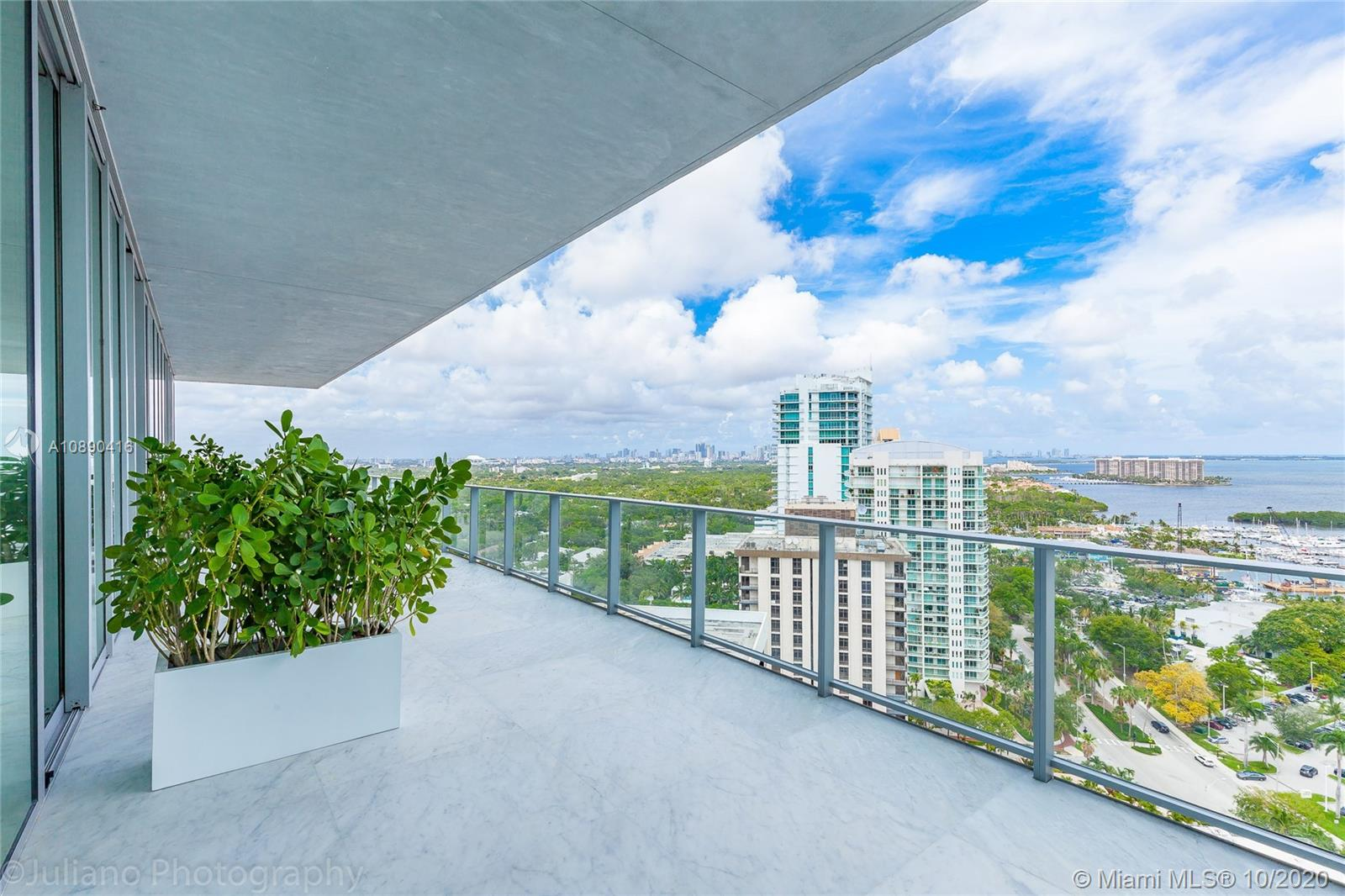 Grove at Grand Bay is an architectural masterpiece.  PH1902N is a Stunning 19th floor, 5213 SF residence.  This 5 BR, 6/1 BTH residence has a 12 FT high ceilings & 12 FT deep terraces offering 180 degree views of Coconut Grove and Biscayne Bay. Beautifully finished with marble floors throughout, wood paneling, marble master bath and Miele appliances. Fully furnished.  Three parking spaces!  Residence offers over 60 FT of frontage.  Amenities include 2 swimming pools, spa, fitness center, children's playground and pet spa. A must see.