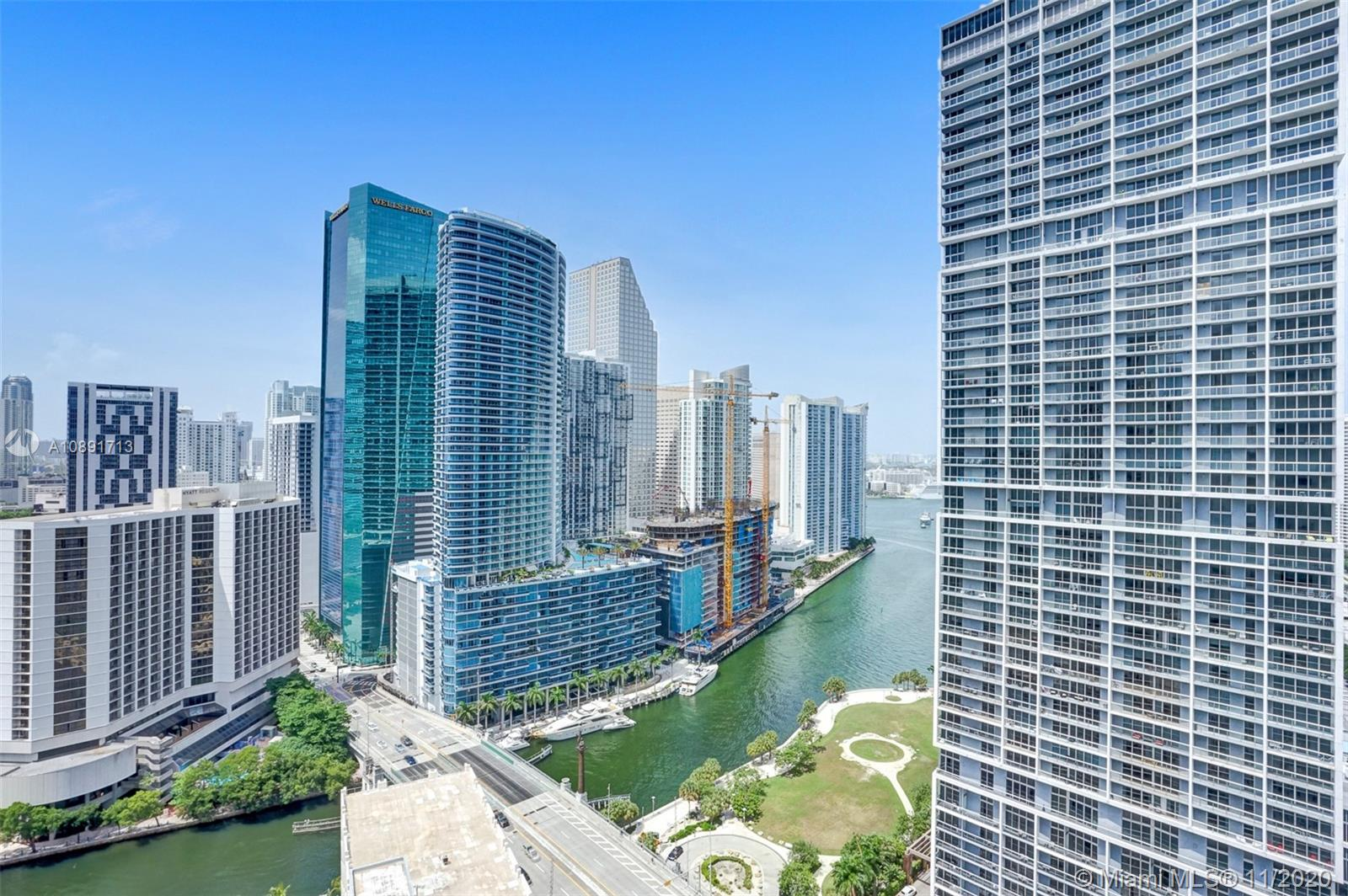 Come see this Spectacular split floorplan unit at 500 Brickell Condo.  It is the most remodeled unit I have seen in the whole development.  Marble floors throughout, Custom ceilings with accent LED lighting, TV's built in to Bathroom walls, Venetian plaster accent walls, Built out Custom Closets & Motorized shades on all windows.  Unit faces the mouth of the Miami River leading to Biscayne Bay, which the Water can be seen from both bedrooms & living room.  A NE Water View that will never be taken away in the future.The development is located right on Brickell Ave. Cafes, Restaurants, Bars, Salon, Dry Cleaners, Banks, etc just downstairs in retail space of the bldg.  Amenities include 2 Pools, Large Gym, Spa, Movie Theatre, Billiards, Party Rooms, 24 HR Doorman & Business Center. Call Now
