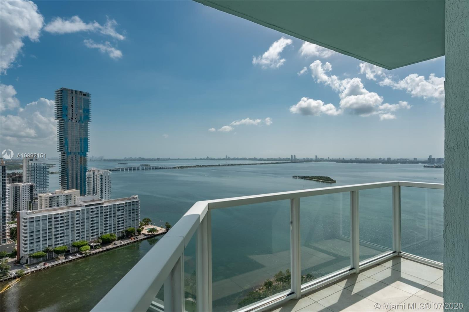 Gorgeous views and lots of storage space in this updated 3 bedroom 3 bath condo at Quantum on the bay. Wood flooring throughout. Custom Closets and additional custom built storage at entrance. His and her sinks in bathroom with large walk in closet. 2 balconies with great views of the bay, inter coastal waterway and lots of city views. Quantum has world class amenities including 2 pools, movie theatre, multiple community rooms for lounging or holding events. Incredible gym with cardio, pilates, weights and lots of open space for yoga and other types of training. Sauna in gym as well. Pace Park is at the front of building. Shopping is easy with 2 large groceries walking distance and lots of dining options. Easy commute to beaches, downtown, airport, wynwood and much more.