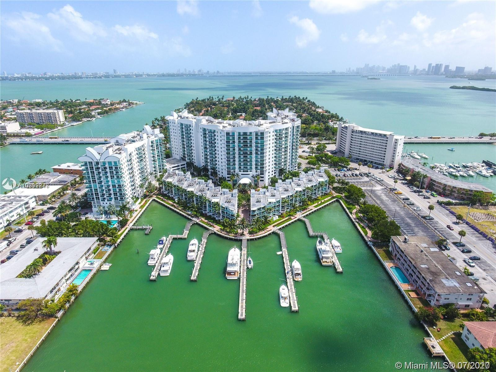 Direct water views from high floor in desirable gated community. Floor to ceiling glass doors and windows overlooking the Miami waters. Gated community with 24 hours security, valet parking, community boat docks, boardwalk by the bay, 2 pools, fitness center, clubhouse and more. Close to restaurants, supermarket and major highways. Less than a mile from the beach!