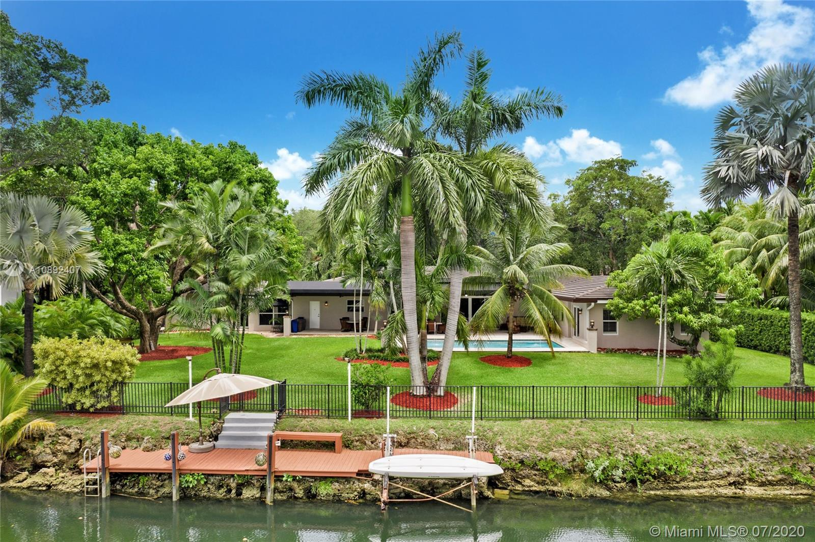 Located centrally in Coral Gables on the historic Granada blvd. This modern waterfront property is a 5 bedroom and 5.5 bath with 5073 sqft living area. The property offers a gated lot, an expansive backyard on the Gables waterway with ocean access, and a swimming pool area surrounded by a large fixed awning. It also features a private master suite, gourmet kitchen, large living/dining area, storage room, and a large den. The property is located walking distance from Riviera country club and the university of Miami, only minutes away from the Biltmore Hotel. Its beautiful natural landscaping offers tremendous privacy.