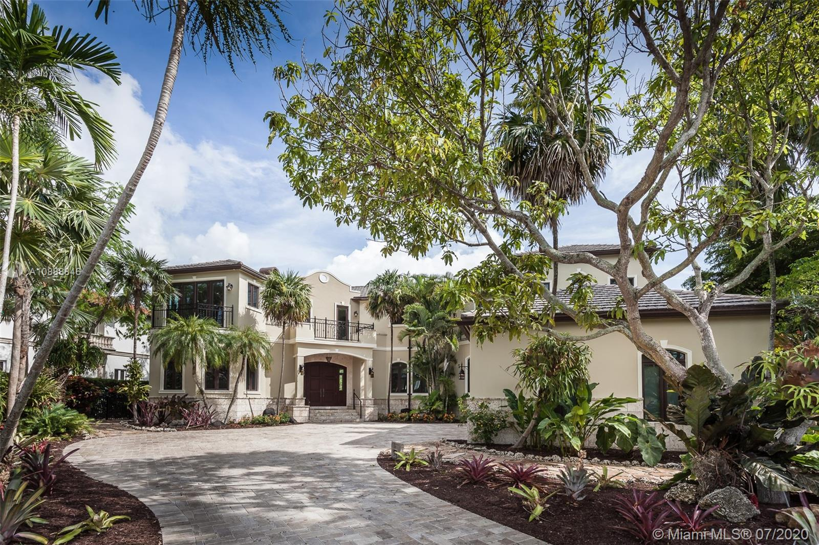 Elegant two-story home in the exclusive Cocoplum gated community. Built in 2003 with 4,901 Sq. Ft. and recently renovated, this beautiful 5BR/5+1BA home on the Coral Gables Waterway has its own private dock and pool, with balconies in the front overlooking landscaped grounds and a tranquil street. A spiral staircase in the patio leads to the terrace of the large master bedroom and seating area. Coffered ceilings with custom murals and custom-molding throughout the home offer a classic and grand look. The updated kitchen features a Thermador gas range with grill stove and warmer drawer, and Sub-Zero refrigerator and freezer with custom cabinet fronts.