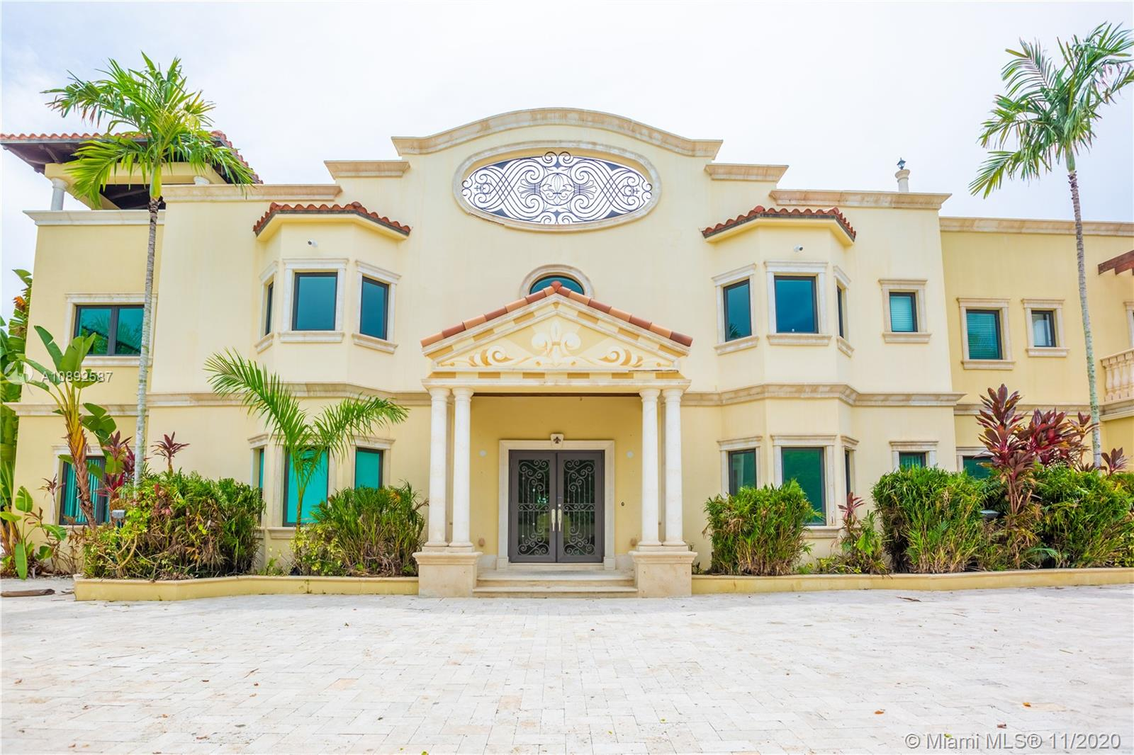 Magnificent 9 Bed/8 Full Bath/2 Half Bath 2 Story Gated Villa in the Heart of Miami. Located on Almost an Acre of Land, This Stunning Home has Amazing Exterior Features Including a Salt Water Pool w/ Spa,Pool Cabana, Covered Back Patio with Fountain, Roof Top Terrace W/Cabana to Entertain Family and Friends,a Pond with Bridge and Luscious Landscaping.Interior Features Include White Ceramic Tile Floors,an Elevator,Grand Staircase, a Laundry Room with Chute From the 2nd Floor, and Maids/In-Law Quarters. Master Bedroom Has Its Own Fire Place, 2 Walk-In Closets, and Master Bath Features His and Her Bathrooms, His and Her Sinks, Separate Tub and Shower. To help visualize this home's floorplan and to highlight its potential, virtual furnishings may have been added to photos found in this listing