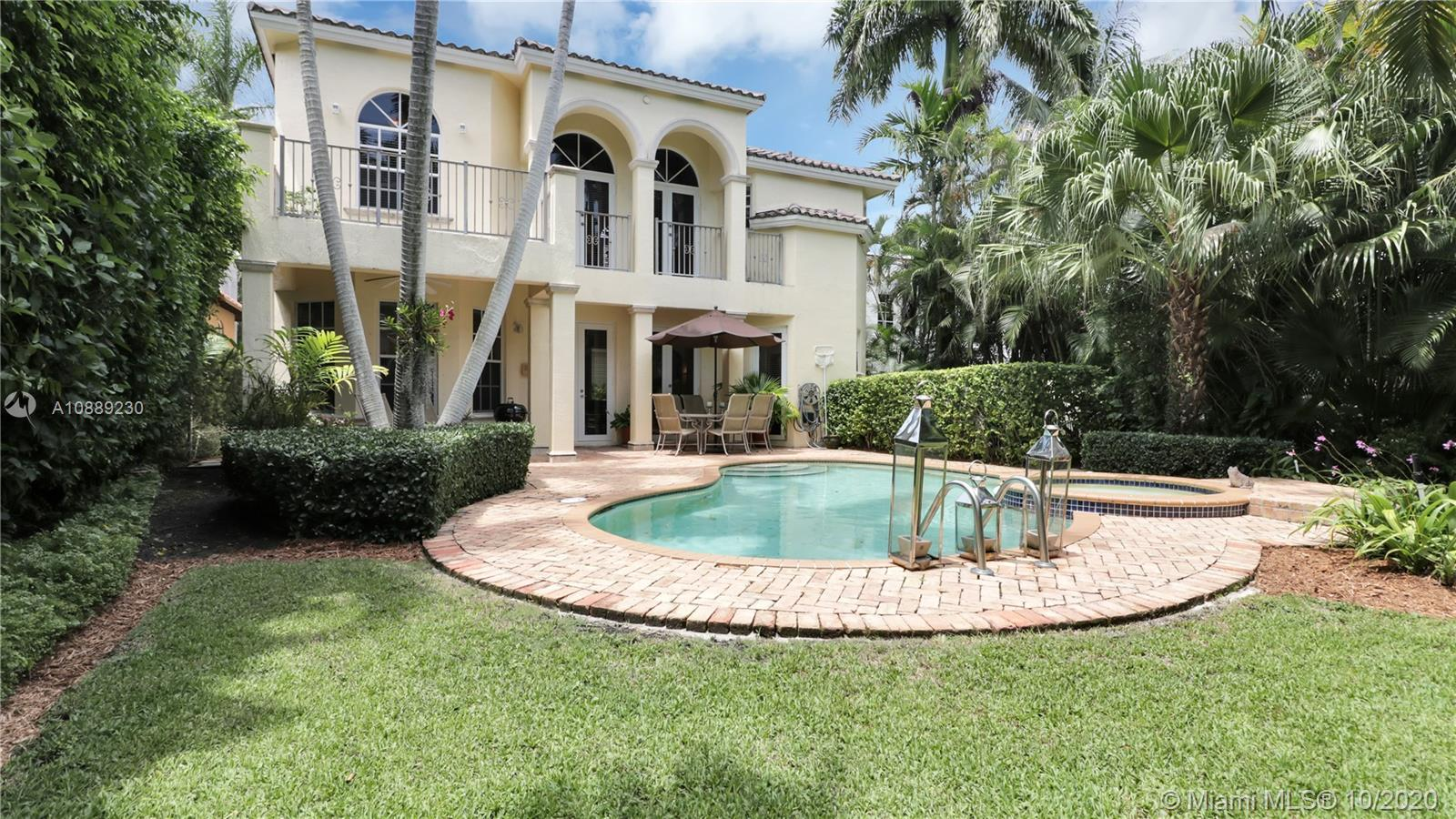 Built in 2000, this turn key 4/4 1/2 Mediterranean gated home located in Coral Gables is minutes from Miracle Mile. Nothing was spared with this beautiful yet functional layout. Special features include vaulted ceiling in living room, foyer, formal living and dining room, guest bath, pantry, laundry room, recently updated kitchen in 2020, family room, breakfast area, large downstairs bedroom with full bath, and huge two-car garage. Upstairs includes over 9 ft. ceilings, two bedrooms, each with en-suite baths & walk-in closets, and a luxurious master bedroom with two walk-in closets, and a spacious renovated master bathroom. Master bedroom has 2 separate charming balconies-one overlooking the private interior courtyard, and the other overlooking the pool/spa and mature garden.