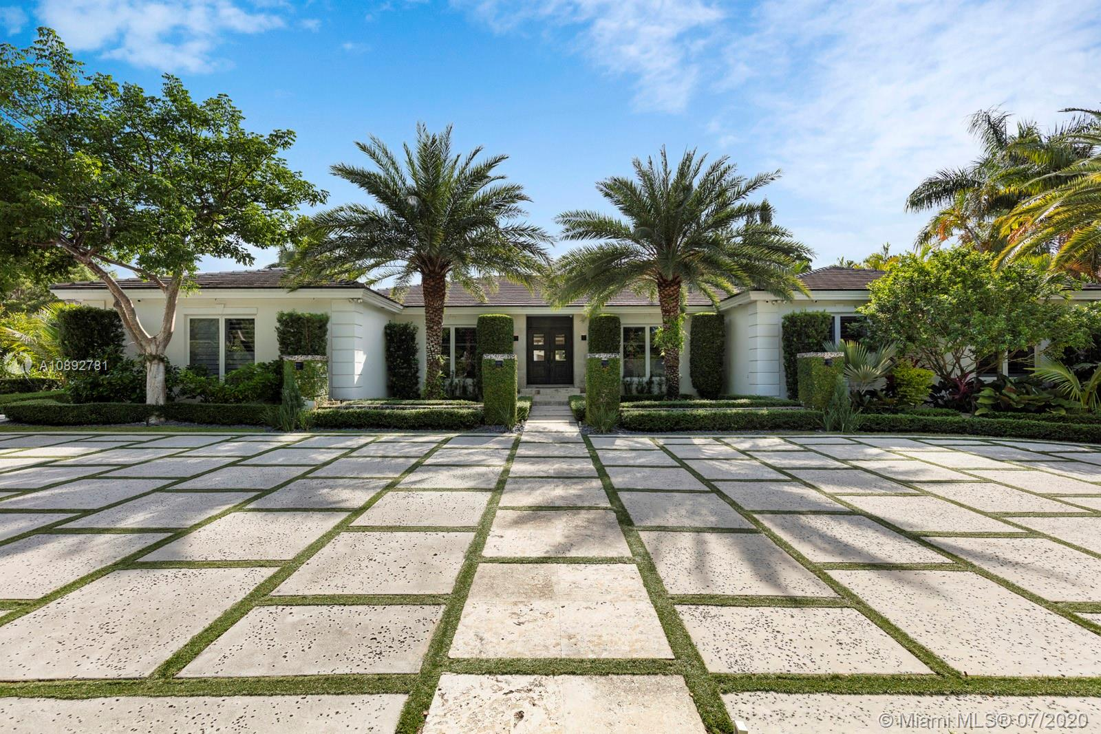 Once in a long while a spectacular offering comes to market  that is perfect for enjoying Florida living at its best!  Such is the case with this 5 bedroom, sleek, traditional on the outside, but totally 21st century on the inside home on a highly desired corner lot!  With some 6,000+ s.f., this beautiful open floor plan accommodates the most discriminating buyers.  Not only does the home have a media room/movie theater, it boasts a playroom, 2 car air conditioned garage, lavish master suite, gourmet cook's kitchen and much, much more. The 25,000+ s.f lot provides the perfect backdrop for the inviting pool and surrounding gardens.  No detail has been overlooked in making this a home everyone will love.