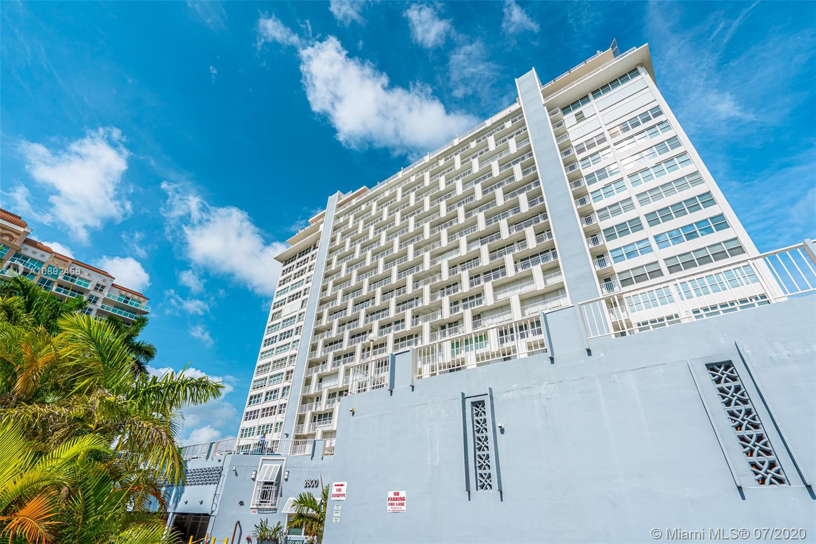 """Updated waterfront 2bed/2bath high (18th) floor condo with expansive intercoastal, ocean and lush park views. Luxury gated building just steps to the beach with great features like stylish common areas, semi-private elevators, forever views from roof top pool and gym. High Impact windows & doors. Unit features large balcony and waterviews from every room. Open kitchen with premiumn SS appliances,  custom cabinets, granite countertops & backsplash.  You have your own great room for entertaining with living room, dining area and kitchen all open with access to the balcony. Beautiful 24"""" porcelain floors add elegance. Large owners suite faces the ocean. Renovated bathrooms too. Pets to 25lbs are welcome with a covered pet walk. Full size Washer/Dryer in unit. Don't miss it!"""