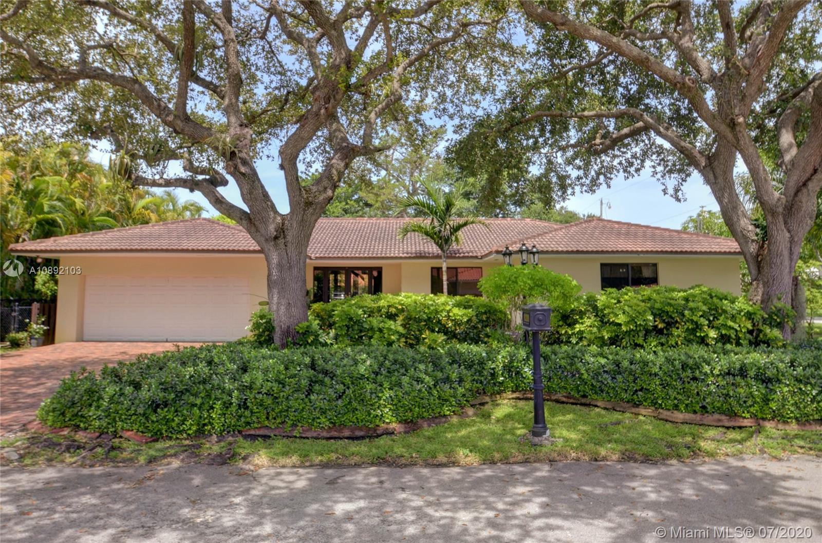 This spectacular 4,100 sq ft home is situated on a cul-de-sac on a stunning 13,450 SF CORNER lot in the heart of South Miami! Front doors open to a lovely foyer, formal & informal living room boasting 4 bed/3bath with the open living plan overlooking a lushly landscaped yard w/ a variety of fruit trees and a 100 yr old Banyan tree. Yard is lined with a gorgeous 100 year old limestone wall.  Features include huge kitchen, gas range, w/ all new Samsung appliances, lots of natural lighting, skylight, custom wood ceilings & trim, extra large laundry room, ALL impact windows & doors, well & sprinkler system, transfer switch for generator, gorgeous patio with plenty of room for a pool!   Home is within close proximity to the top schools, walking distance from parks, hospitals and many hot spots!
