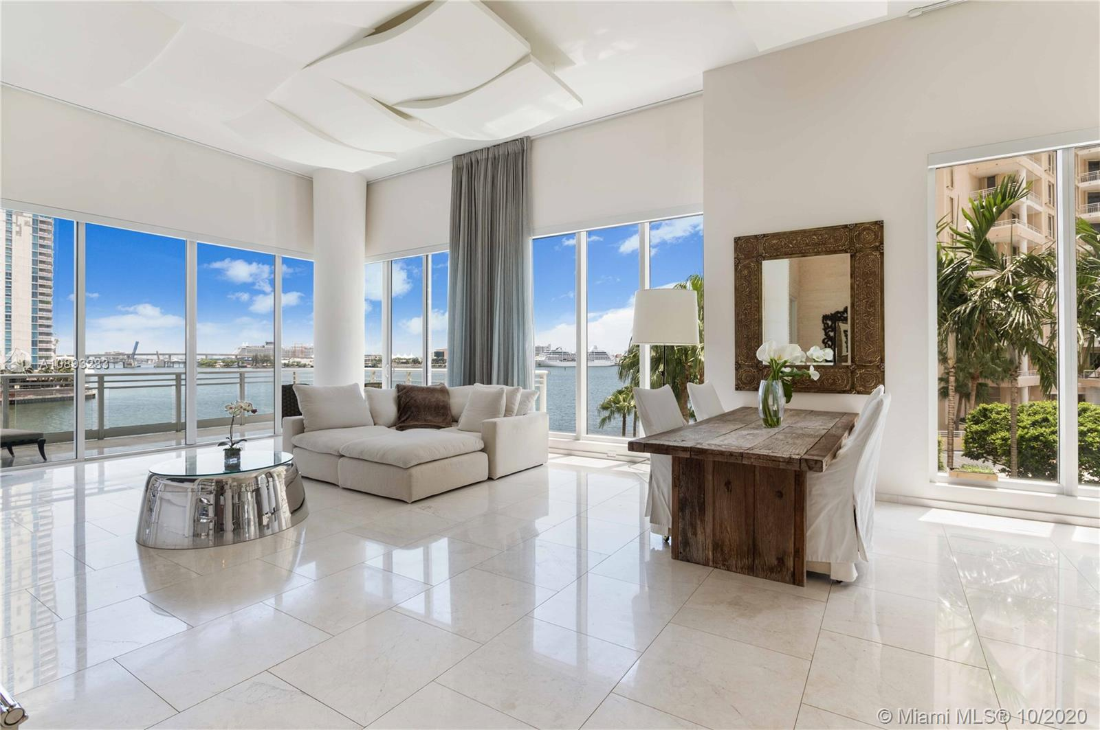Huge Brickell Key, 4,631 Sq Ft, 2 story condo townhouse connected by a glass spiral staircase incl. 4 beds, 4 full +2 half baths. Direct waterfront, corner unit, where you can enjoy the sunrise, cool breezes & city views while relaxing on one of the 4 balconies including a wrap around. First floor has 14-foot ceilings; second floor has 12-foot ceilings. Enjoy your own private elevator, 2 gourmet kitchens w/ top-of-the-line appliances, a personal infrared sauna inside the unit, parking for 8 cars, 2 storage rooms conveniently located next to the unit. Asia is a luxury boutique building with full amenities, guest valet parking, 24-hour concierge, tennis courts, racquetball, gym, pool. Walking distance to restaurants, marketplace, parks and playgrounds. Marketed exclusively by Techrin Hijazi.