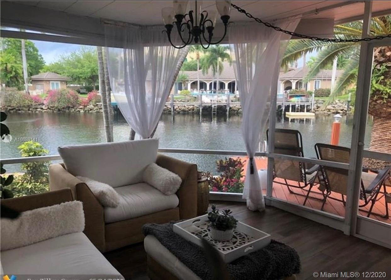 Gorgeous property with 100' of waterfront on a wide bend of the Middle River, this East Wilton Manors home with scenic water views from every room awaits your vision. 