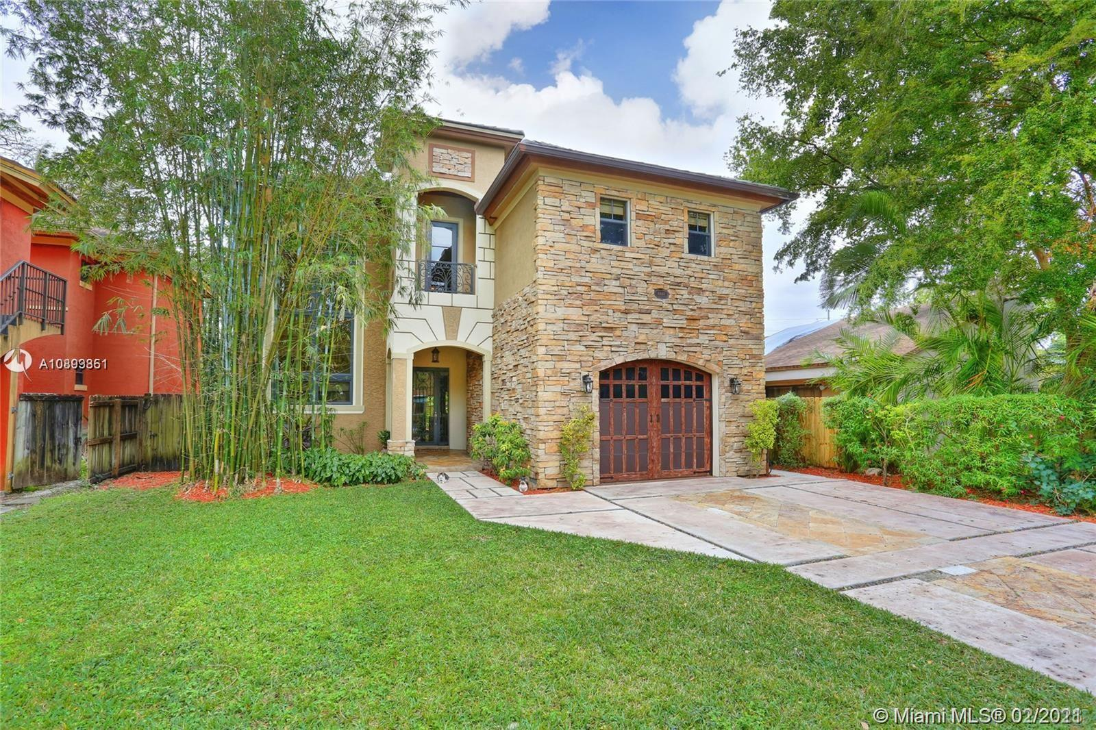 """Beautiful majestic stone clad Home in South Miami. (Smart House with everything included). Soaring living room, designer kitchen overlooking travertine patio & built in amazing hot tub. All impact windows & doors. Huge Master features balcony overlooking patio & enormous walk in closets. Unique, high-end finishes: onyx topped vanities in baths, exotic imported wood & marbles, beautifully detailed iron railings, marble & wood floors. All bedrooms have en-suite baths. Chef's kitchen w/5 burner gas range; electric double ovens, new Bosch dishwasher, Electrolux refrigerator, Franke sink, 2 AC zones. Lovely details include amazing built-ins throughout. one-car garage with electric door opener. This beautiful and """"smart home"""" is perfect for family get togethers and entertaining. Perfect location"""