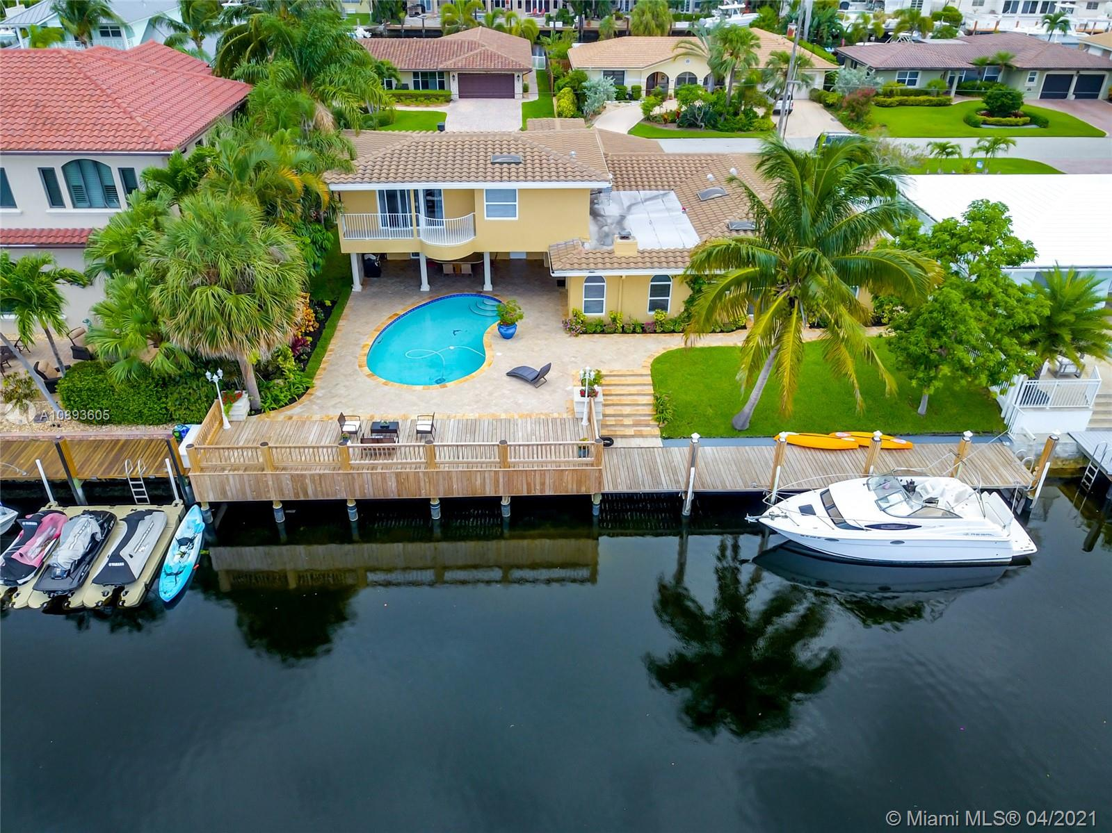 Remarkable home in desirable Venetian Isles section of Lighthouse Point that features 90 ft of waterfront, private dock with power & water, no bridges to ICW and within minutes to Hillsboro Inlet and the ocean. This gorgeous 4-bedroom, 4-bathroom home is filled with natural light and features renovated kitchen and bathrooms, Spanish marble downstairs & hardwood floors upstairs, a huge Master suite on the 2nd floor with balcony facing East where you can watch the sun rising over the waterway every morning. The spacious outdoor features a lanai overlooking the beautiful pool, the patio/deck and the waterfront canal making this home an amazing place for family living and entertainment. Hurricane impact windows throughout. Roof installed in 2015, new A/C and brand new deck.