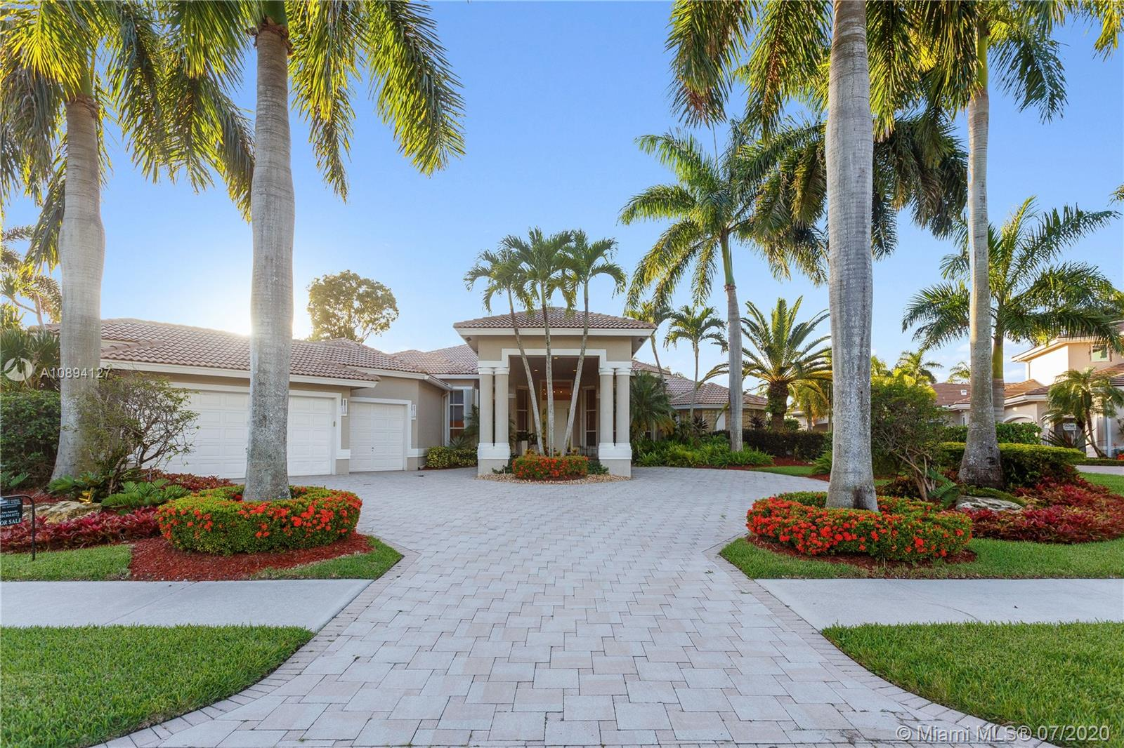 Magnificent home, impeccably renovated, in the prestigious gated community of Weston Hills Country Club. Located in the premier section of Royal Palm, with panoramic golf views, this luxurious and stylish estate includes 5 Bed/6.5 Bath + 2 Offices + Media/Game/Playroom, and a spectacular outdoor Gourmet Kitchen – perfect to entertain! The impressive entry takes you to a stunning and elegant living, designer decorated, with custom build-ins and high-end finishes. Marble and wood floors throughout, solid wood doors, among other upgrades. Luxurious master suite, recently remodeled. Crystal chandelier in the dining room included. Access to excellent A-Rated Public Schools. This home is simply extraordinary and unique!